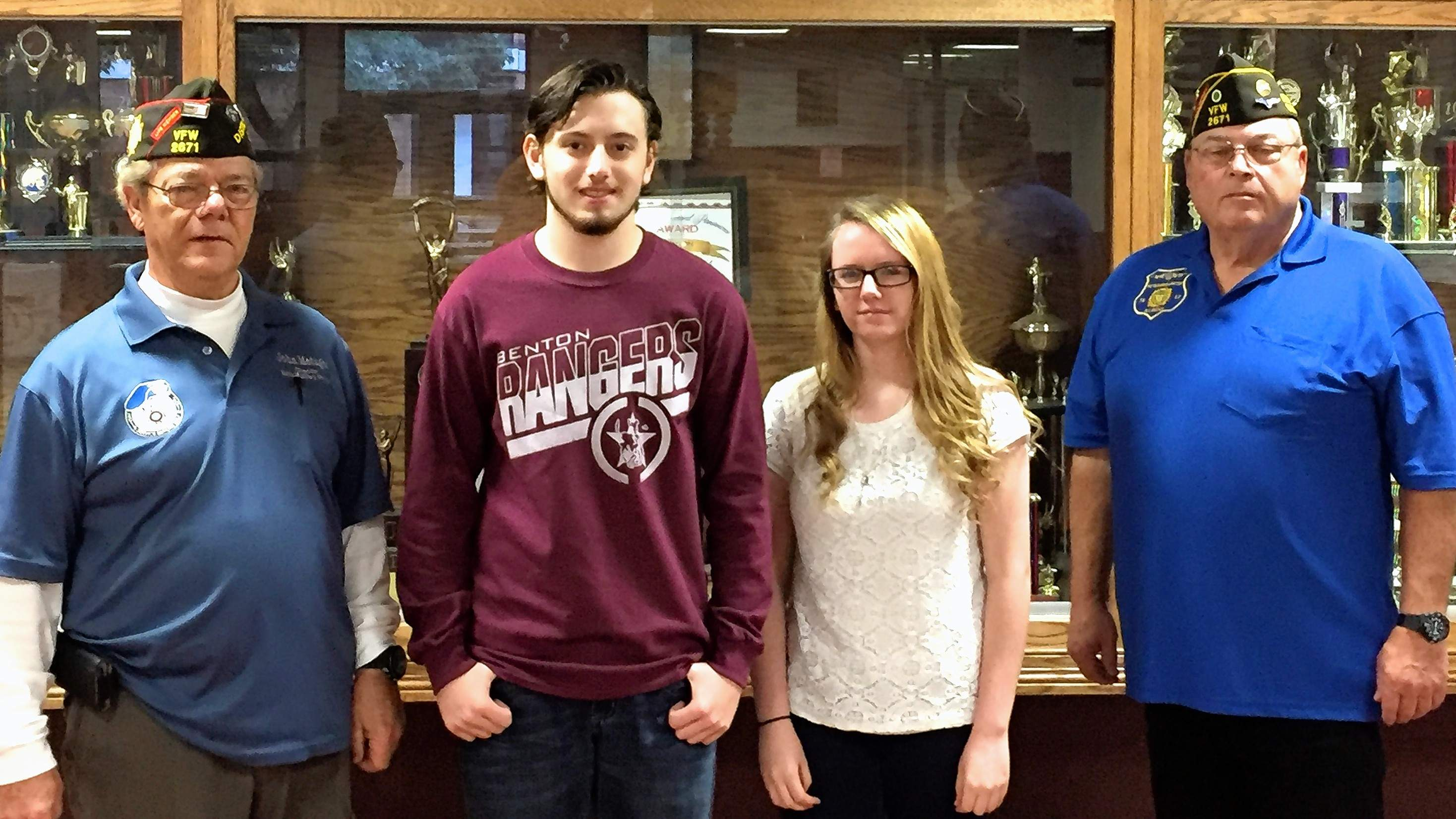 Benton High School named two school winners in the VFW Voice of Democracy competition. John Metzger (left) and Gary Gravel (right) presented award certificates to juniors Carson Hill, first place, and Gabriela Wysong, second place.