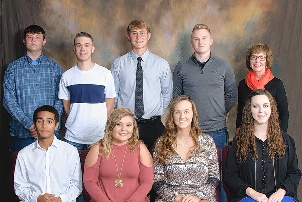 Black Diamond Harley Davidson Scholarship recipients (front) Anthony Welling (Mt. Vernon), Tylar Hanson (Bluford), Mary Linsley (West Frankfort), Alesse Strumpher (McLeansboro, Jonathan Lee (Pinckneyville), Dakota Miller (Sesser), Dalton Banach (Waltonville) and Nolan Domineck (Royalton) are pictured with RLC Foundation Board Member Mary Ellen Aiken.