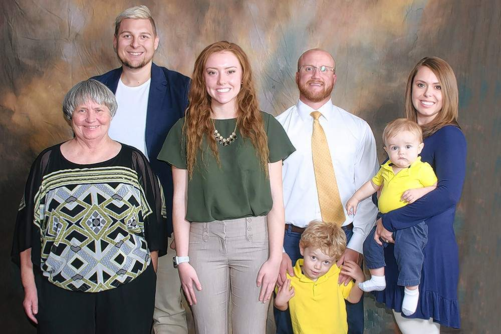 Douglas S. Carlson Memorial Scholarship recipient Emily Bulla (Sesser), third from left, is pictured with scholarship donors Beverly Carlson, John Carlson, Scott Carlson, Fischer Carlson, Klein Carlson and Kelty Carlson.