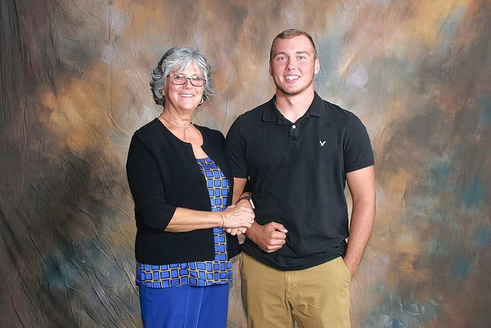 Brad and Brian Evilsizer Memorial Scholarship Scholarship recipient Derek Mueller (Christopher), right, is pictured with scholarship donor Mary Pelosi.