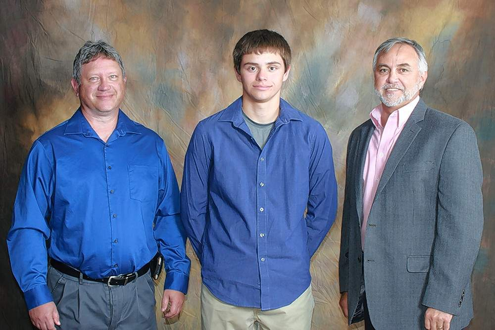 Hamilton County Telephone Co Op Scholarship recipient Jacob Jones (Benton), center, is pictured with scholarship donors Chris Sink and Kevin Pyle.