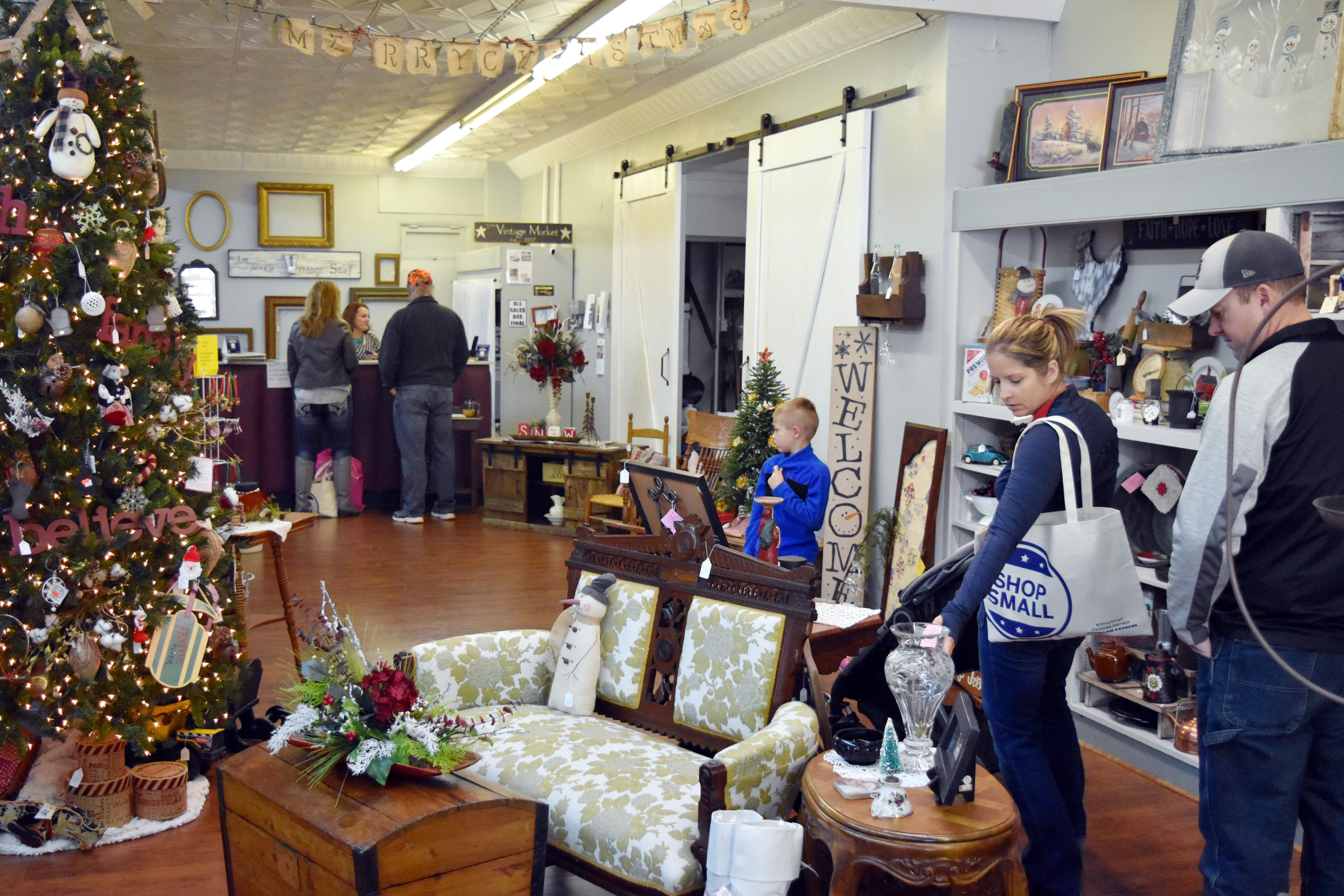 Shoppers view the items for sale at Vintage Market during Small Business Saturday on Nov. 25. The Chester Chamber of Commerce and River City Renewal, Inc., partnered together with city businesses to observe the holiday event.