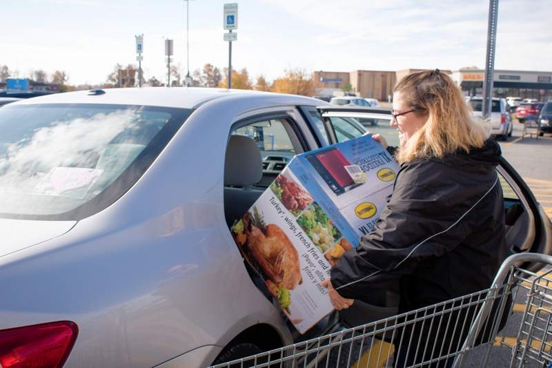kathy akes of marion loads up her car after black friday shopping at marion walmart