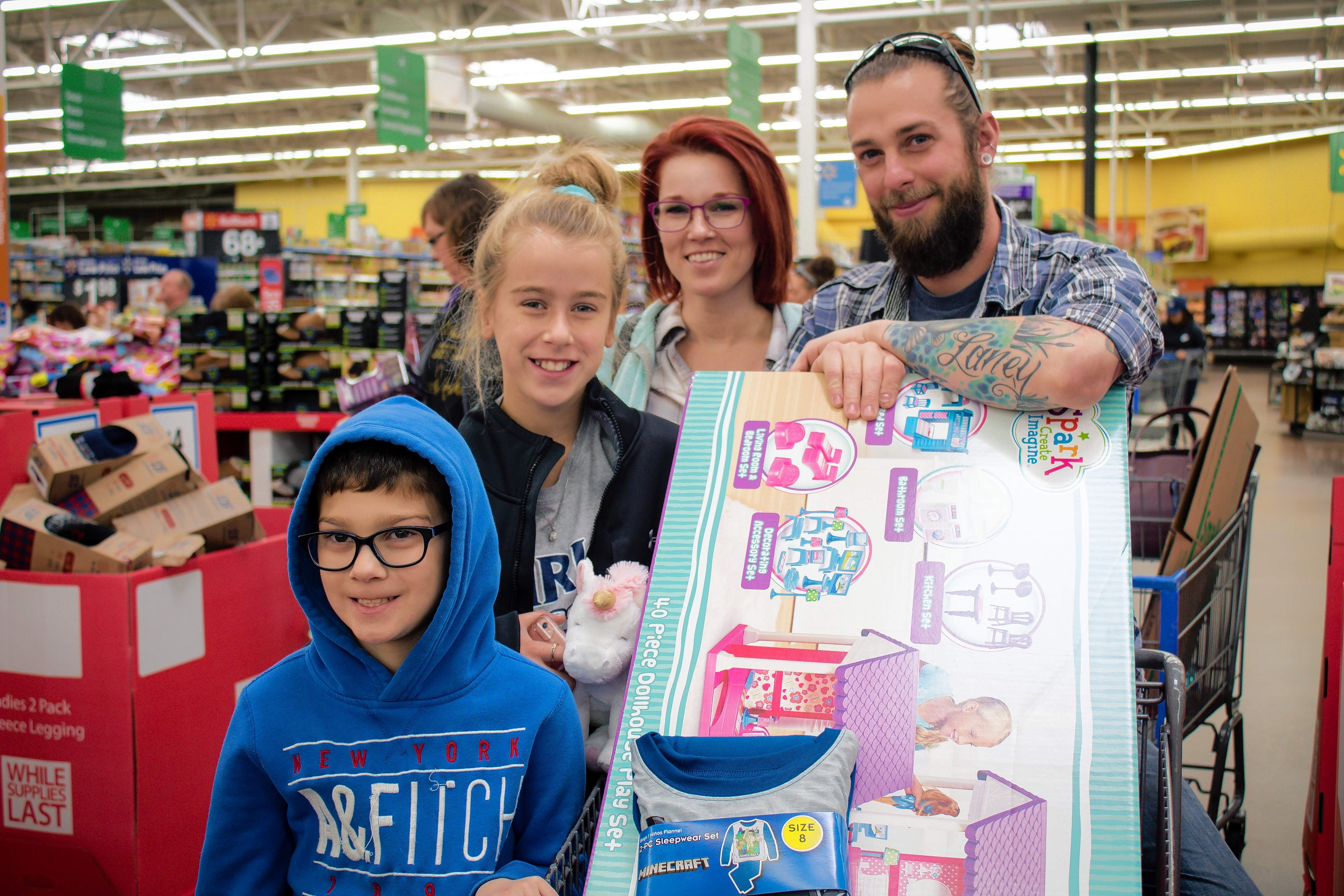 Don Rieger, Alicia Pritchett, Jack Pritchett, and Emma Carter of Marion grab some last-minute deals to check off their Christmas list. Rieger said most of their shopping is done online each year.