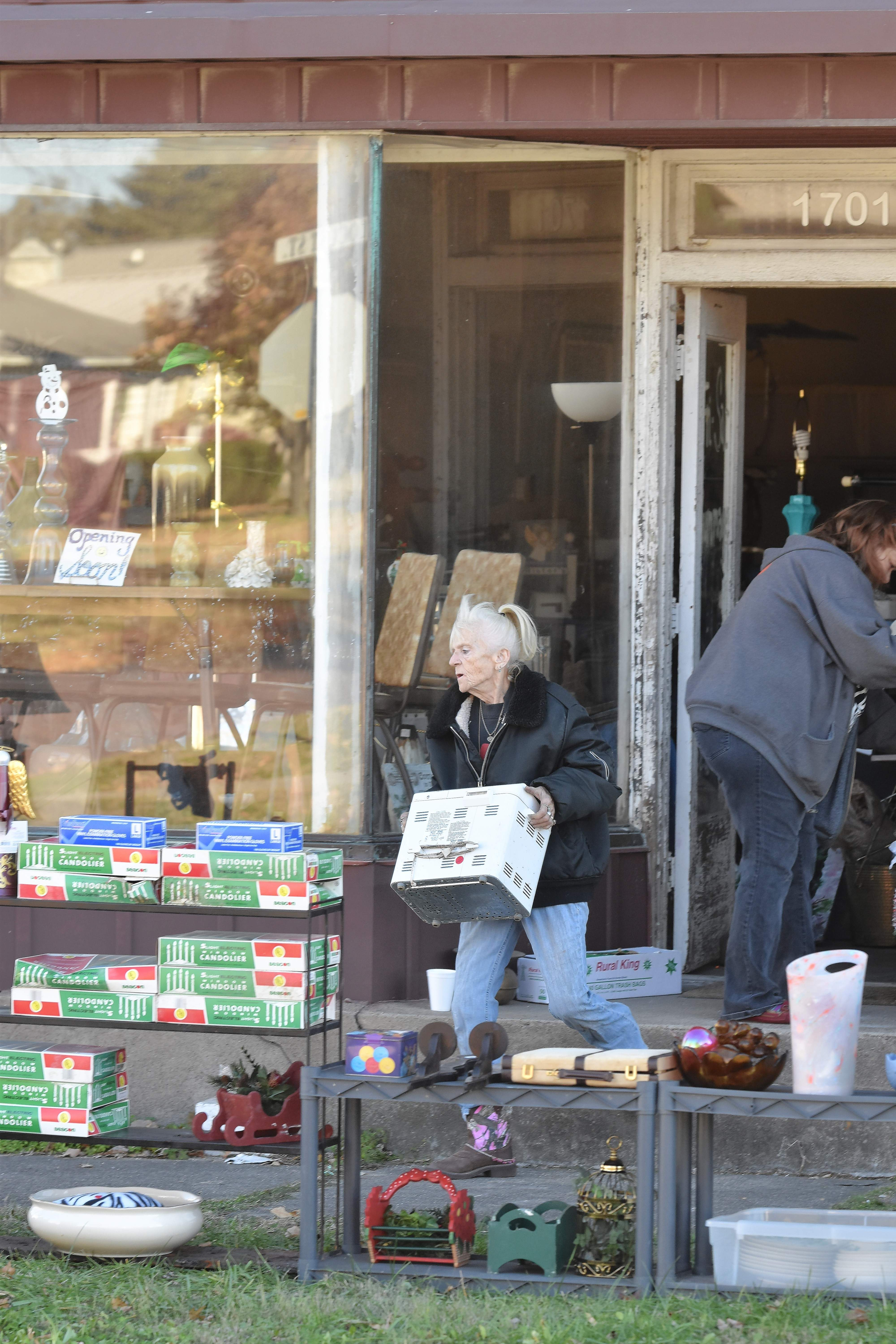 Sandy Gwaltney of Eldorado moves some merchandise as she sets up for the reopening of her business, Cassandra's Forget Me Not ... Again. Gwaltney's old store burned on Oct. 29.