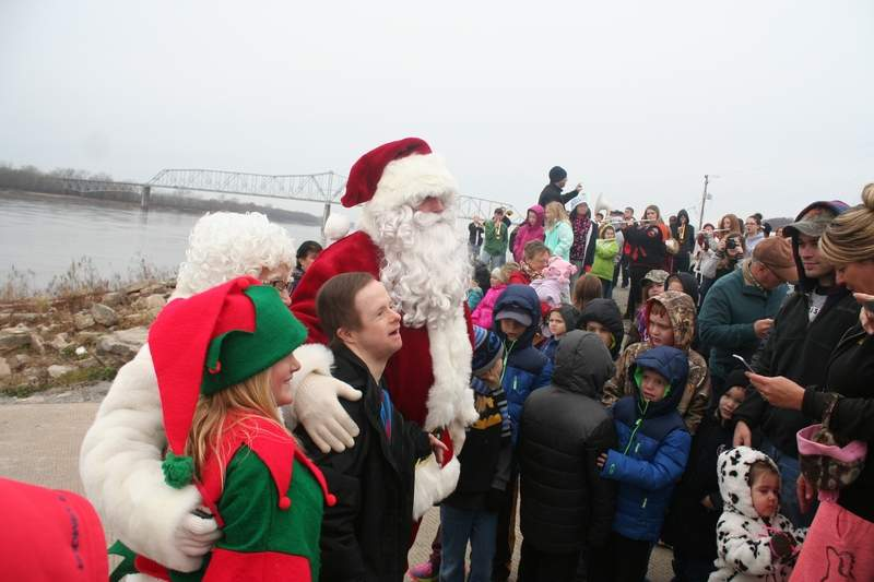 Santa Claus greets well-wishers after arriving at the Chester riverfront via barge during the 2016 Christmas on the River celebration. Santa will once again make his return on Saturday at 10 a.m.