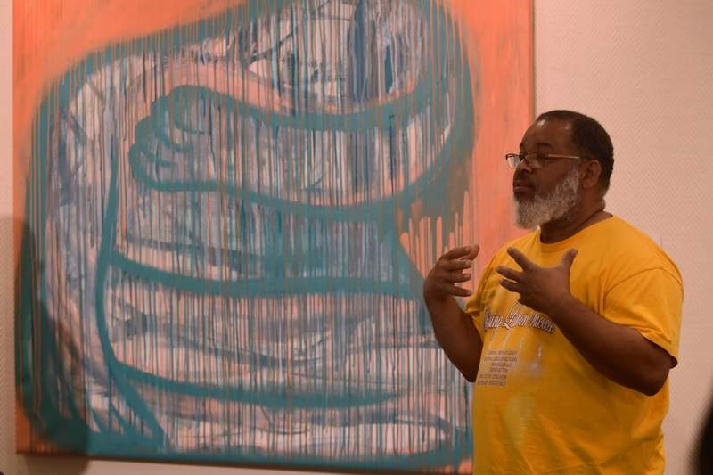 SIUC art professor Najjar Abdul-Musawwir discusses abstraction techniques used in the SIC art gallery display of his students' works Thursday evening. Abdul-Musawwir curated the show, which features the work of SIUC Celine A. Chu Scholarship contest. The show will be on display 8:30 a.m. to 4:30 p.m. Monday through Friday and during special events at the college's George T. Dennis Visual and Performing Arts Center until Jan. 8.
