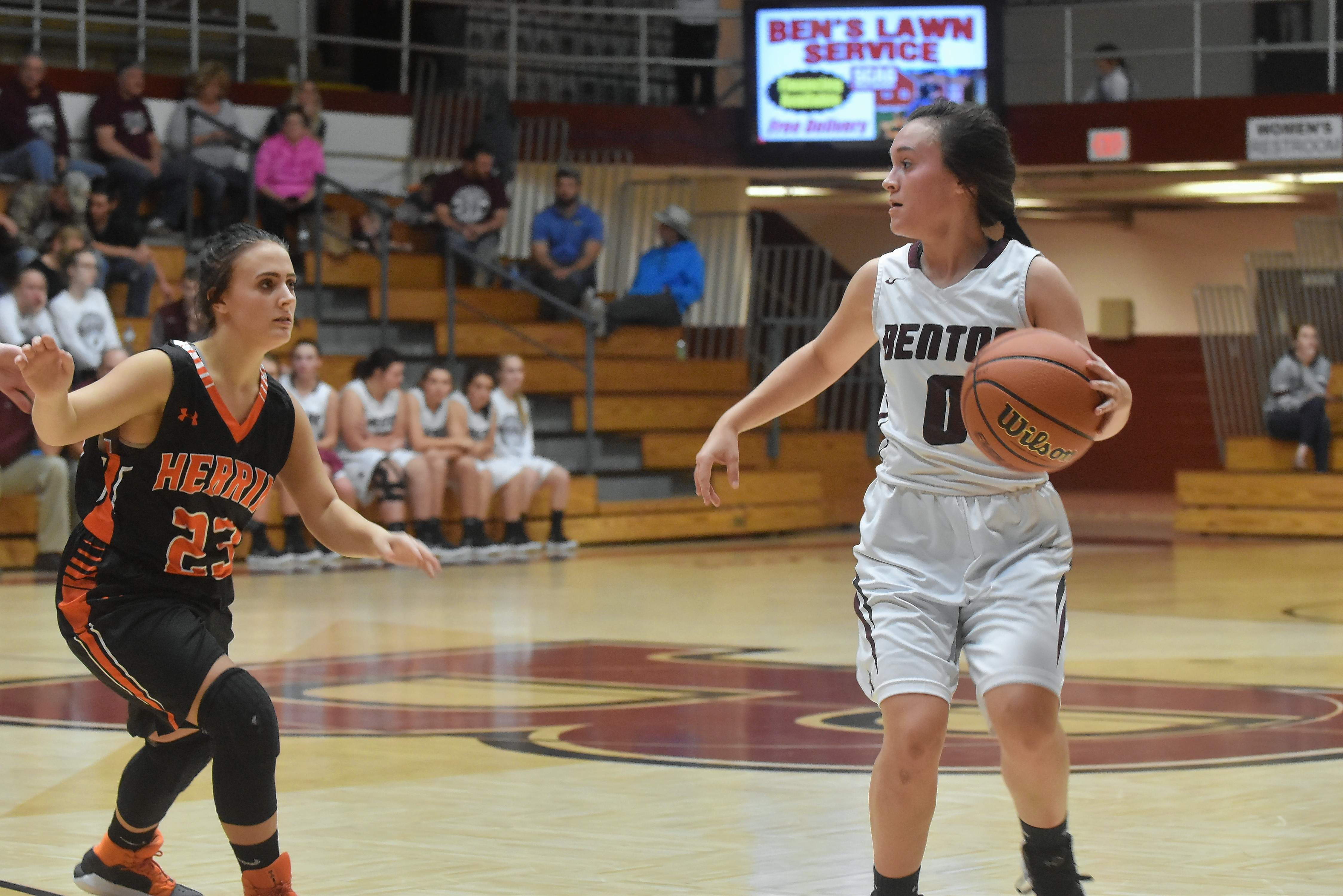 Benton's Eb Casey dribbles away from Herrin's Madison Johnston during the Rangerettes home game Tuesday night.
