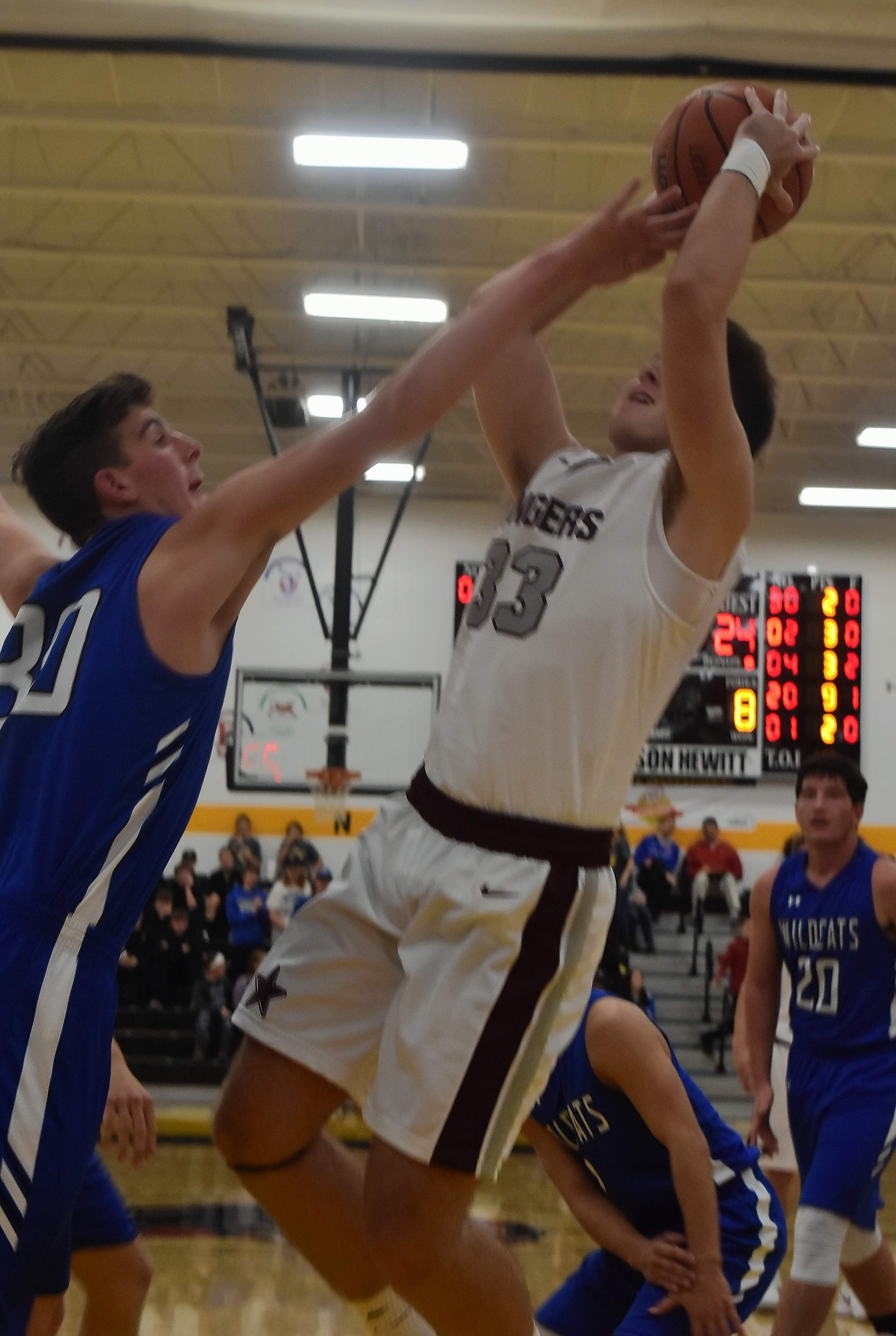 Benton's Parker Williams goes up for two of his 19 points in the Rangers' opening game of the season Monday at the Goreville Invitational Tournament. The Rangers lost a 67-65 overtime thriller to Anna-Jonesboro.