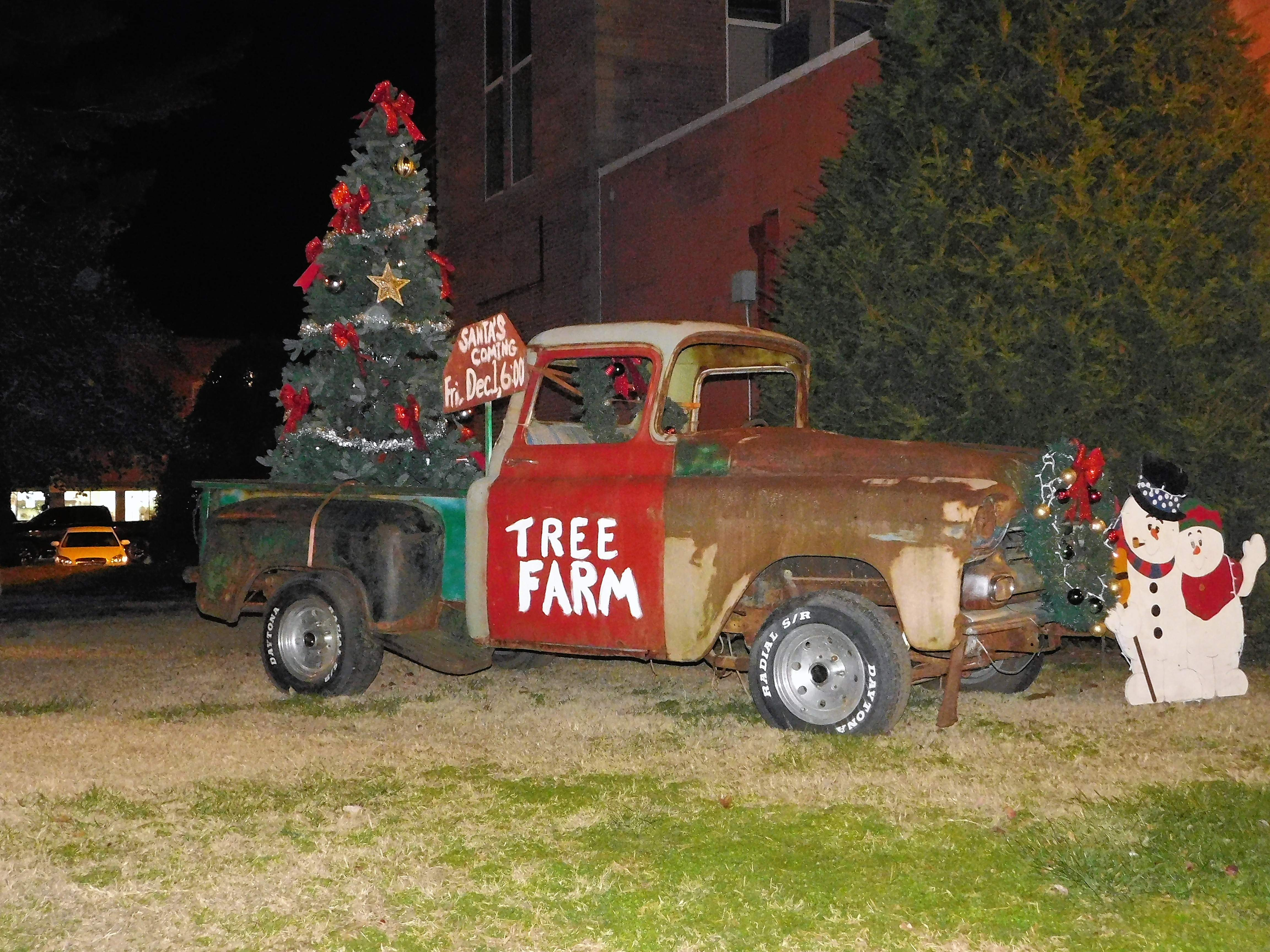 Volunteers spent last week decorating the courthouse lawn in the spirit of Norman Rockwell, complete with a tree farm.  A crowd of about 400 milled about the Benton Square Friday evening to enjoy the decorations.