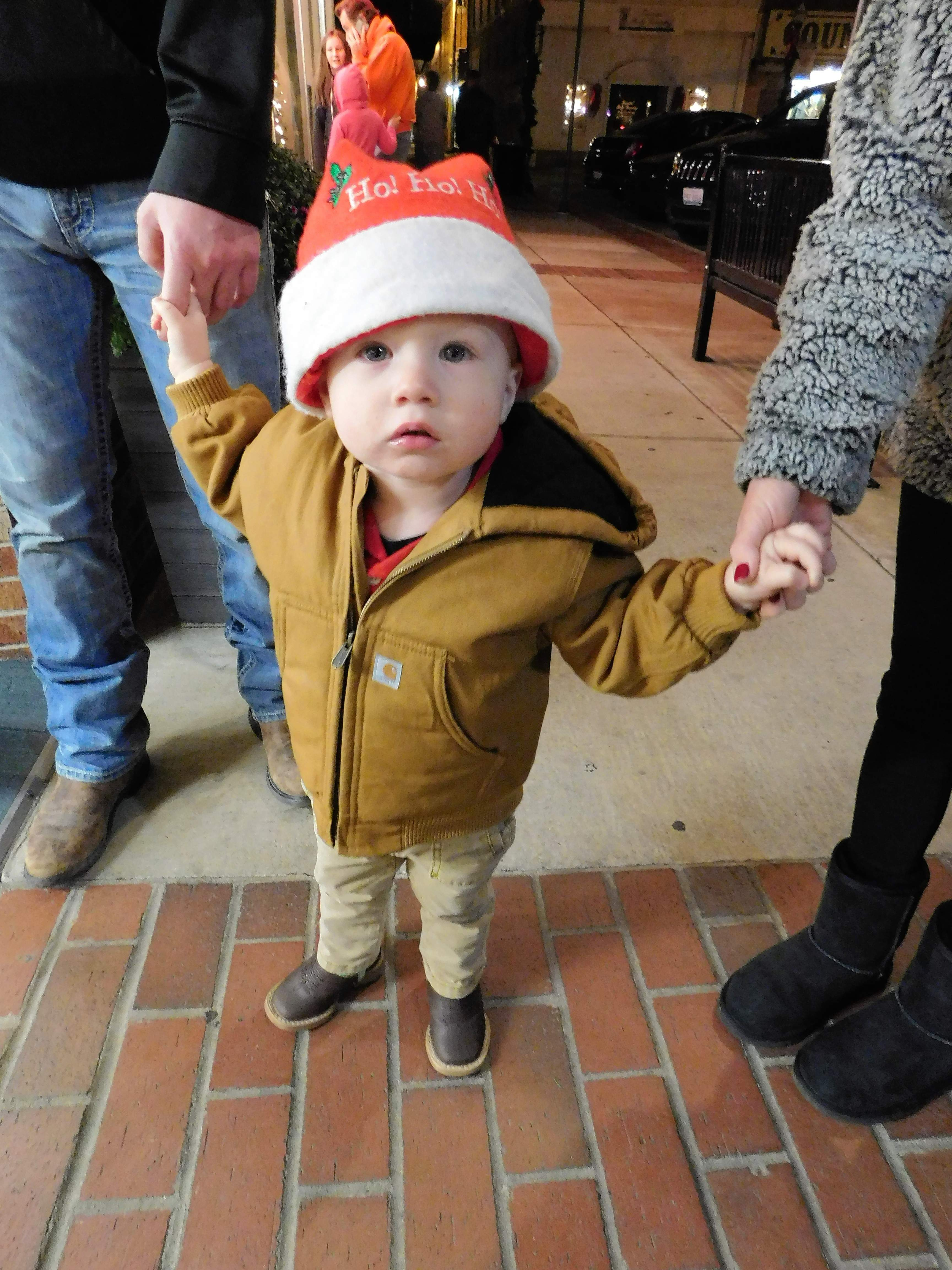 "Easton Hicks could barely take in the lights and festivities at Friday's Festival of Lights in Benton.  Holding tightly to his parents Brooke and Mitch, the almost-two-year-old Easton had his eyes on everything while waiting on the arrival of Santa.  TheThompsonville family was attending the event for the first time.  ""We're making memories,"" said Brooke."