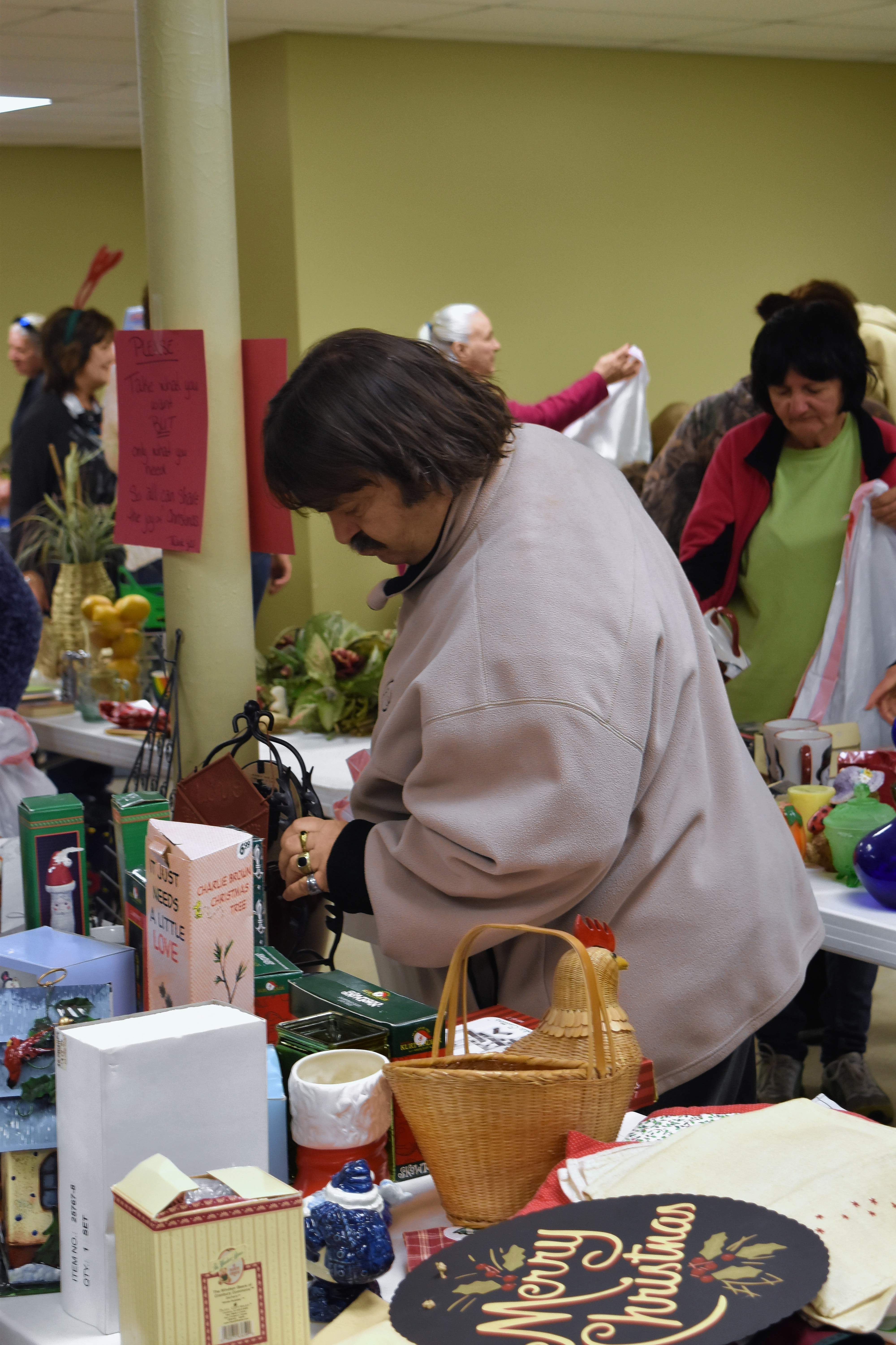 John Rand of Eldorado looks through some of the items available at Star General Baptist Church's Christmas giveaway Monday in Eldorado.