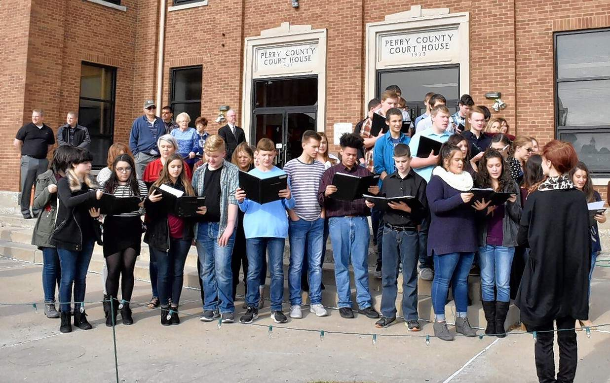 The Pinckneyville Community High School choir sings 'Illinois' Monday outside the Perry County Courthouse.