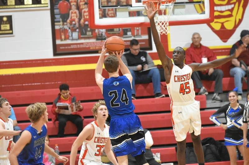 Steeleville's Brad Mevert takes a shot over Chester's Keith Kiner III.