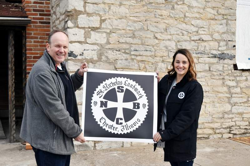 St. Nicholas Brewing Company President Tom Welge, left, and General Manager Abby Ancell reveal the new name and logo of the Landmark building during a press tour event on Nov. 29.