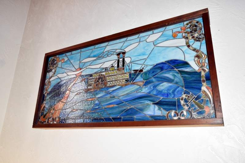 """This stained glass steamboat painting was made by former Landmark co-owner Clifford """"Doc"""" Wright sometime during the 1980s."""