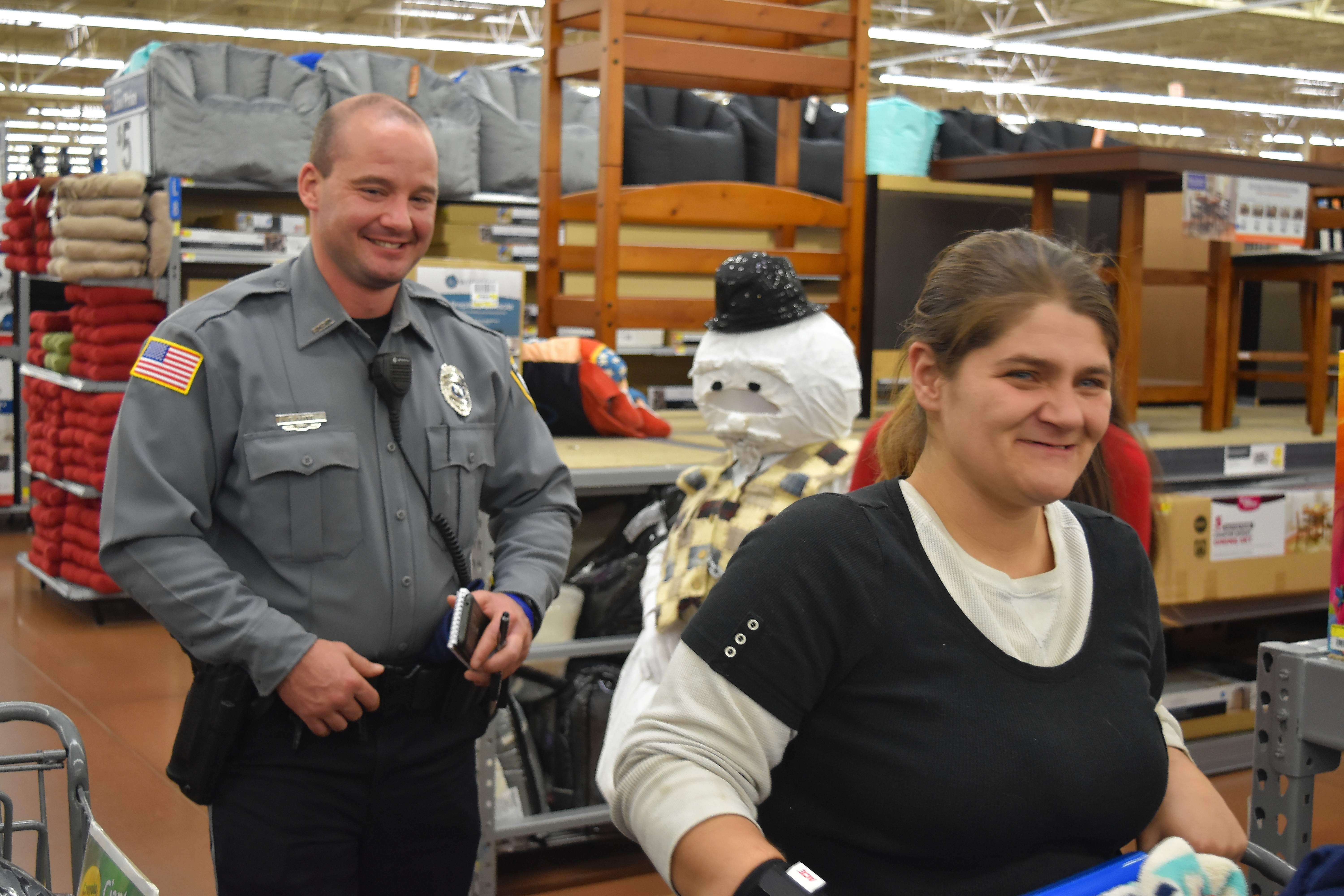 Harrisburg Police Department Officer Eric Gott during Shop With a Cop Saturday at Harrisburg's Wal-Mart.