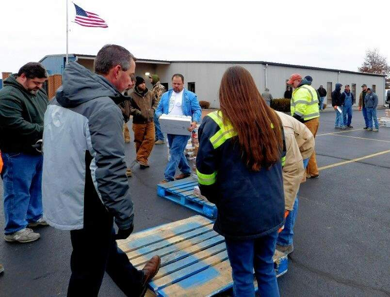 SICLC President Jason Woolard (left) and Marion Kroger store manager Dimitri Lacy coordinates the efforts of more than 100 volunteers Saturday morning, loading food supplies bound for 18 pantries in southern Illinois.