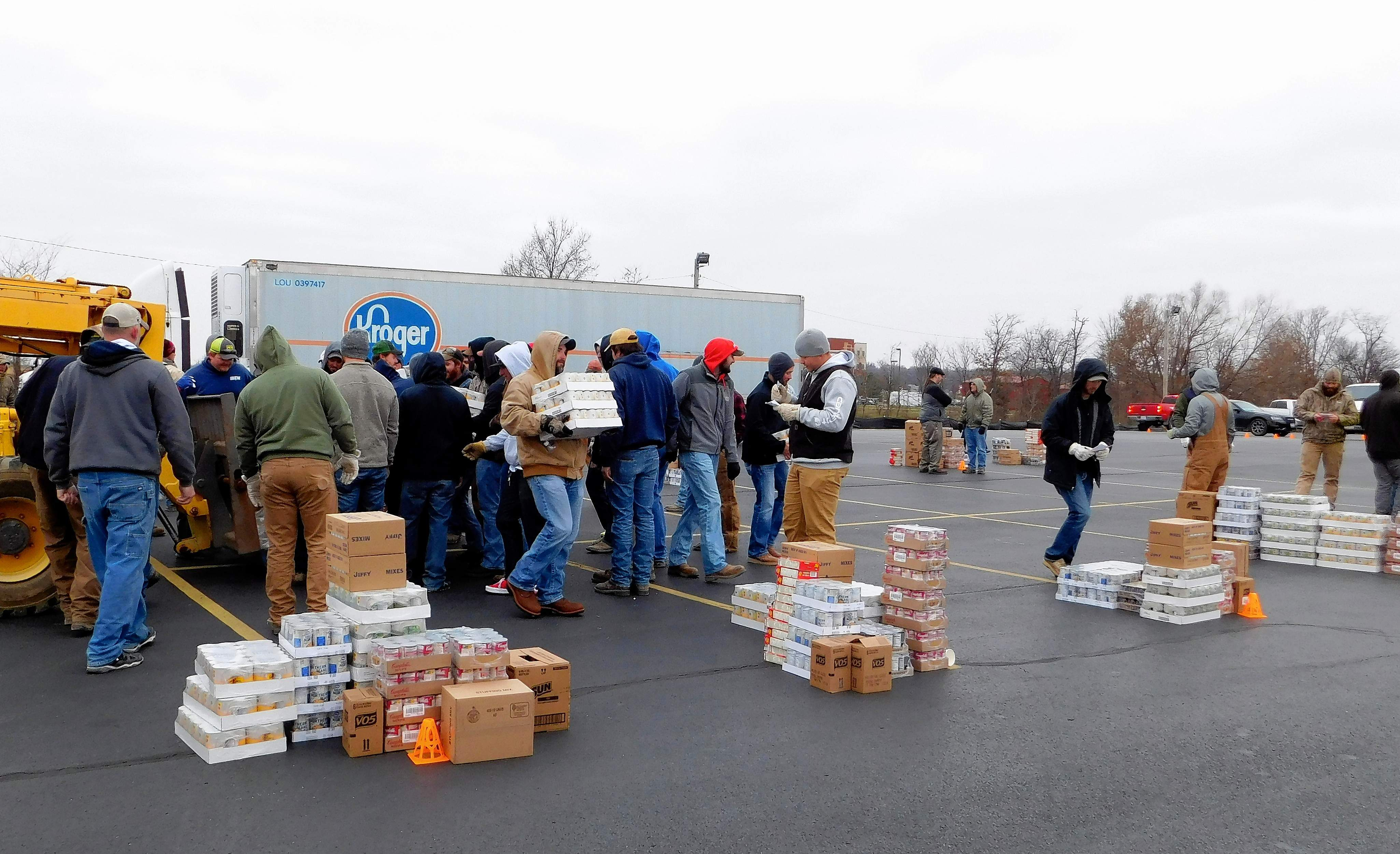 More than 100 volunteers sort and load supplies bound for area food pantries. The partnership provided around $24,000 to those in need.