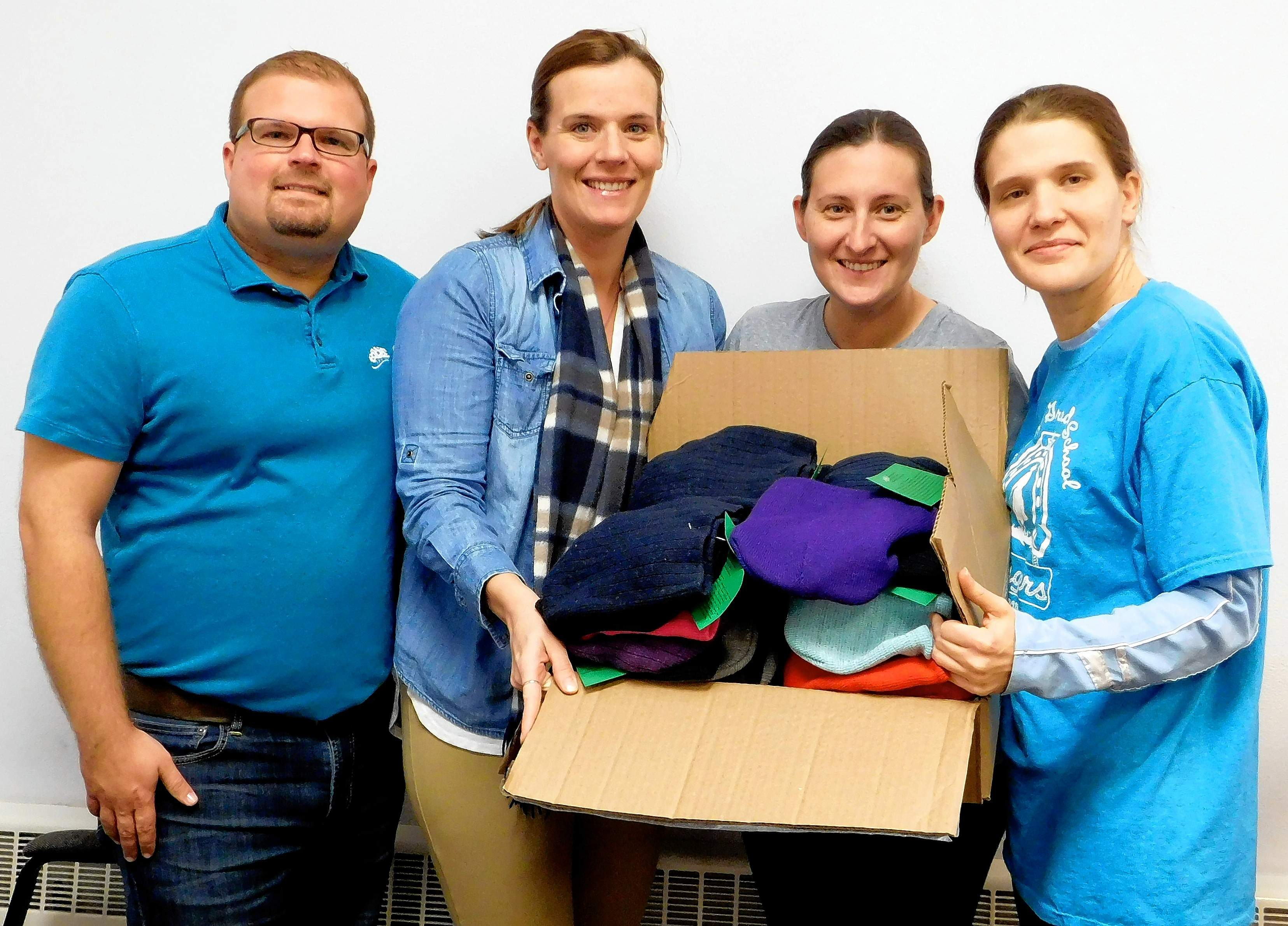 Festival organizers Steven Pate and Rachel Gartner donated a box full of hats and mittens to Benton Grade School PTO president Amanda Anderson and vice president Valerie Keller. 'This is amazing,' Anderson said. 'A lot of kids will benefit from this,' Keller added. The committee was left with about 300 sets of hats and mittens. CASA, the Benton Police Department and Southern Illinois Scarves also benefitted from the donations.