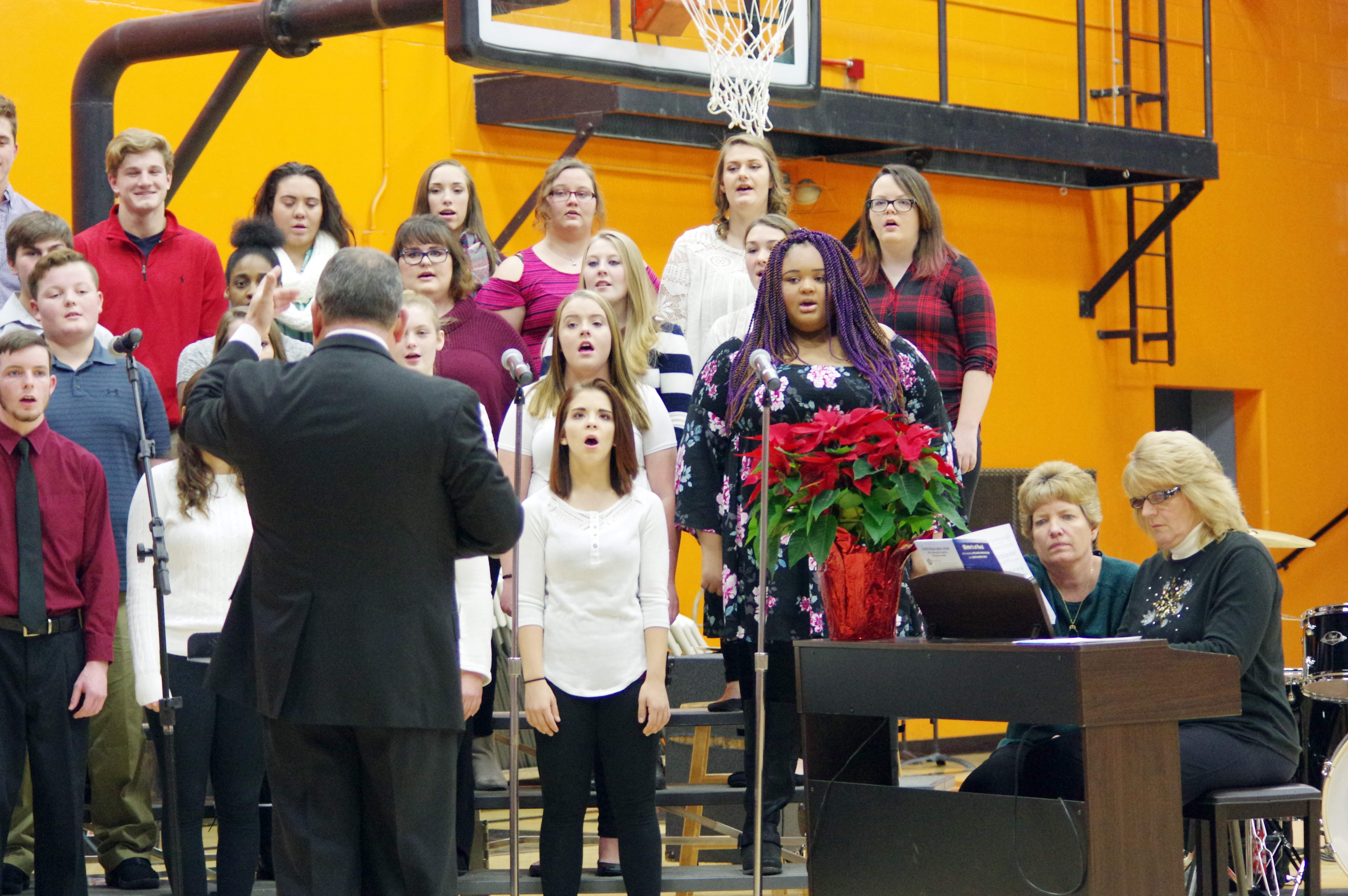 "The Chester High School Concert Choir, under the direction of Steve Colonel, performs at the Christmas Concert. The group performed ""Winter's at Hand,"" ""Good King Wenceslas"" and  ""Carton Christmas."" To the right are Vicky Beers, accompanist, and Sue Colonel, CGS Band director and general music teacher."