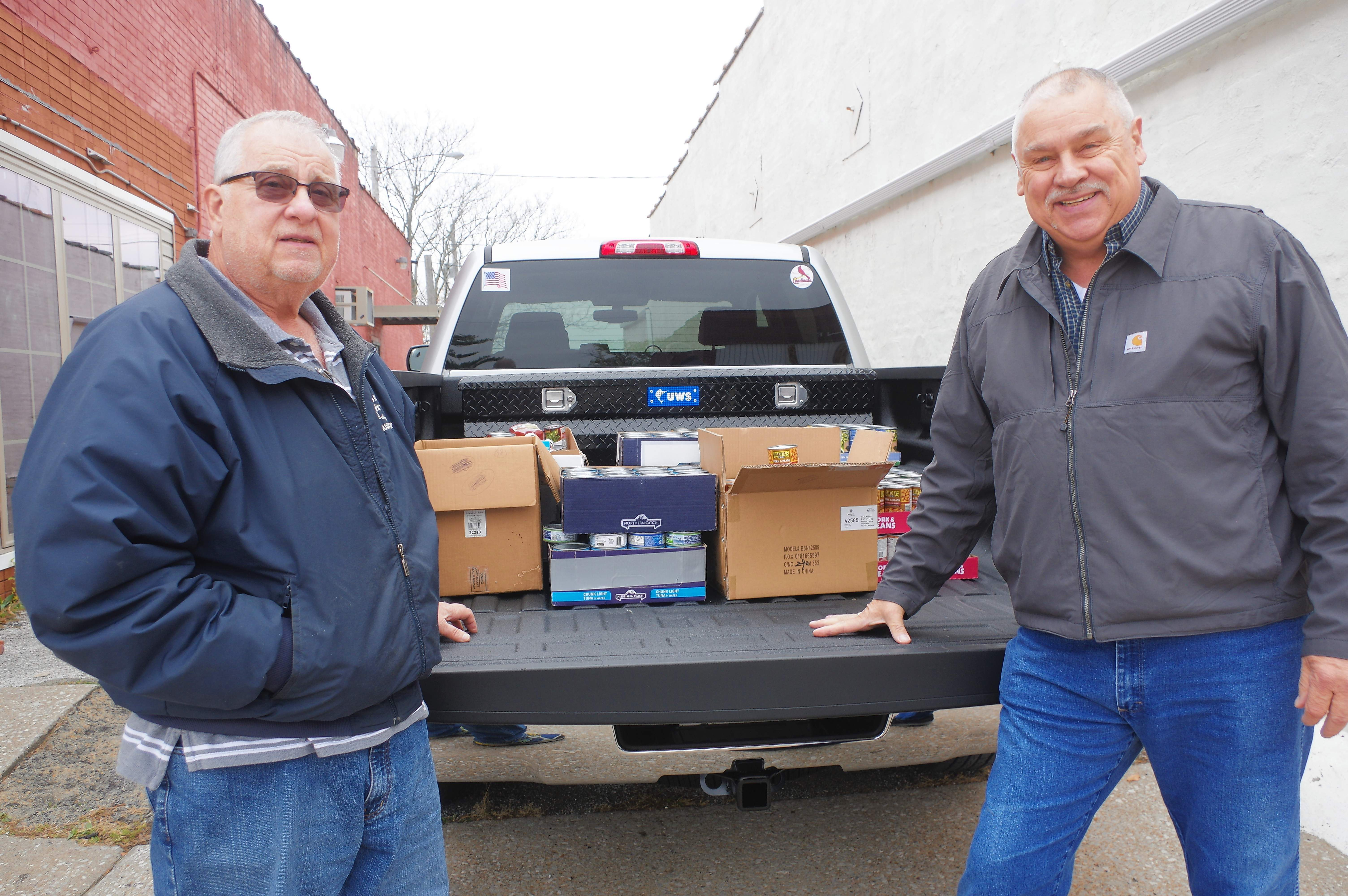 Jim Buch, right, and Larry Brown, of the AFSCME Retirees Sub-Chapter 56, load Buch's truck with 800 cans of food, which were delivered to the Baldwin Lutheran Church Food Pantry.