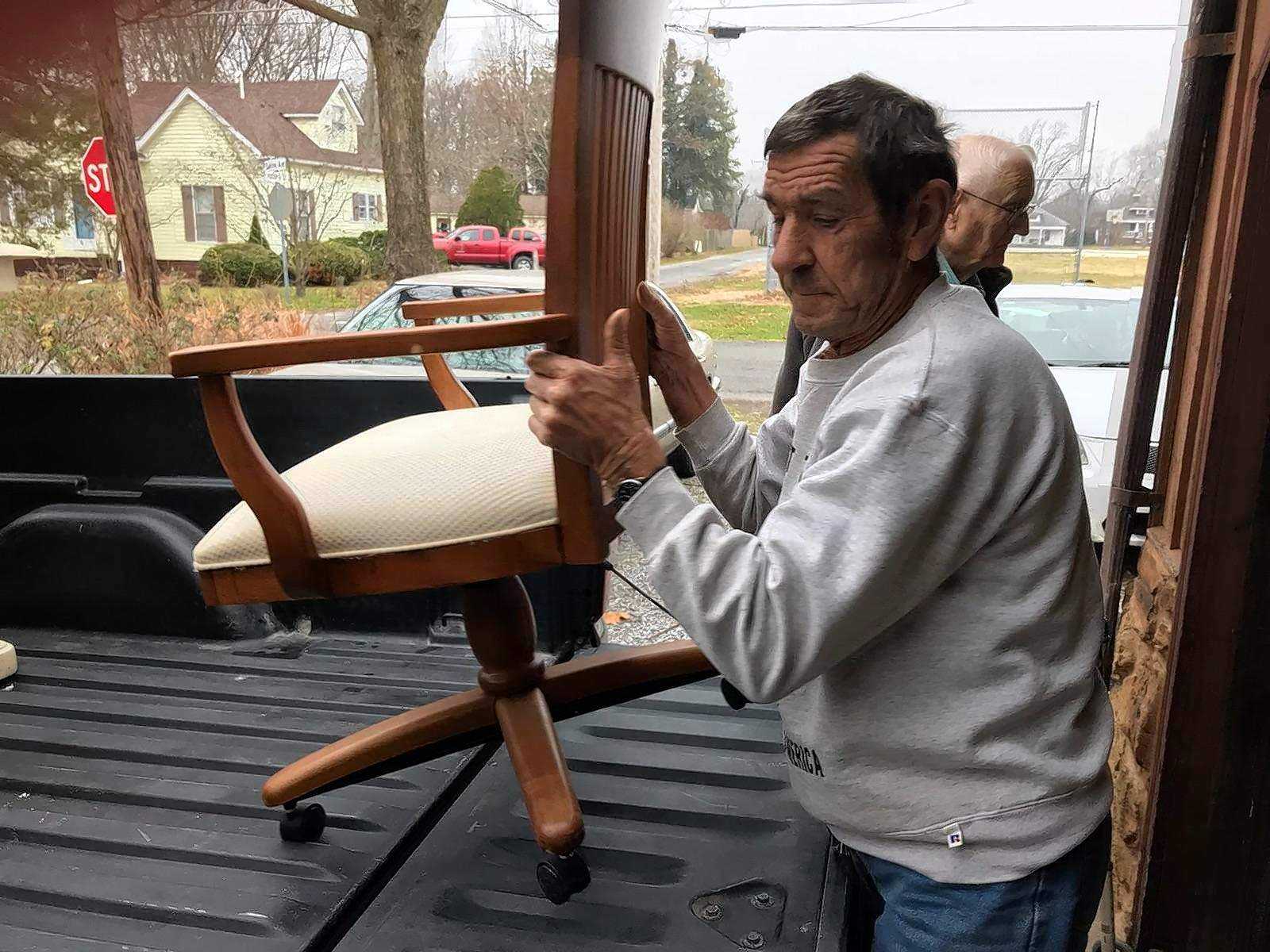 Kermit Coffee unloads a chair from his truck and delivers it to the home of Debra Tipton of Eldorado Friday.
