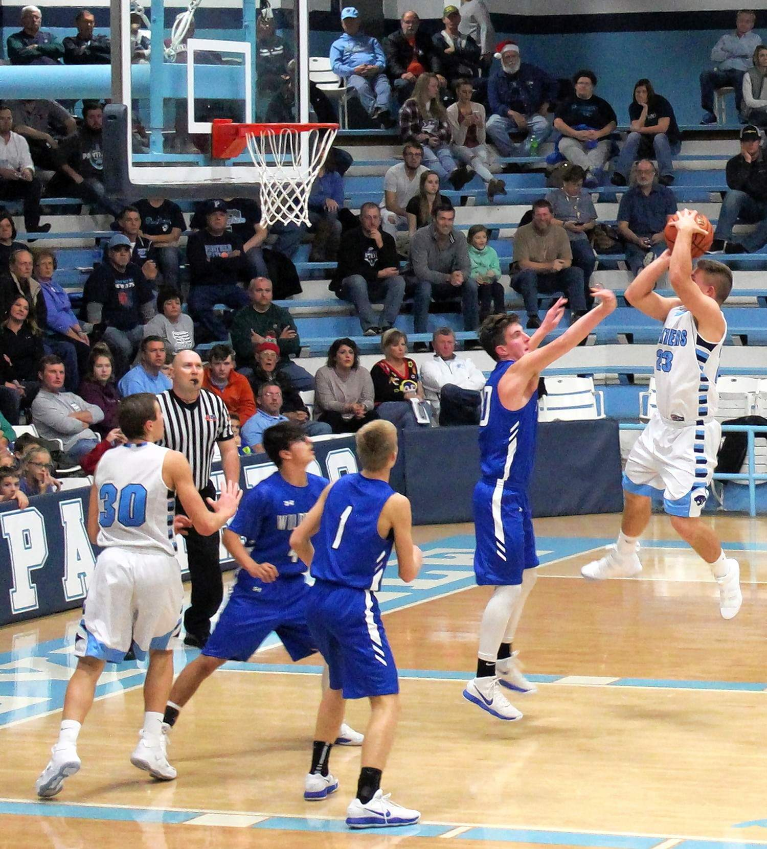 Tyler Rice hangs in the lane and shoots for two in the second half of the Panthers' win over the A-J Wildcats.