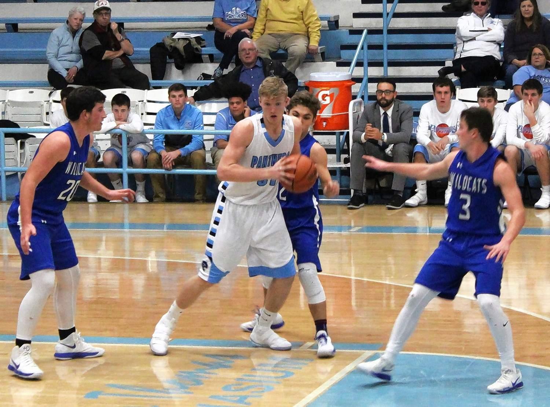 Pinckneyville center Tanner Spihlmann draws three Wildcat defenders in the lane.