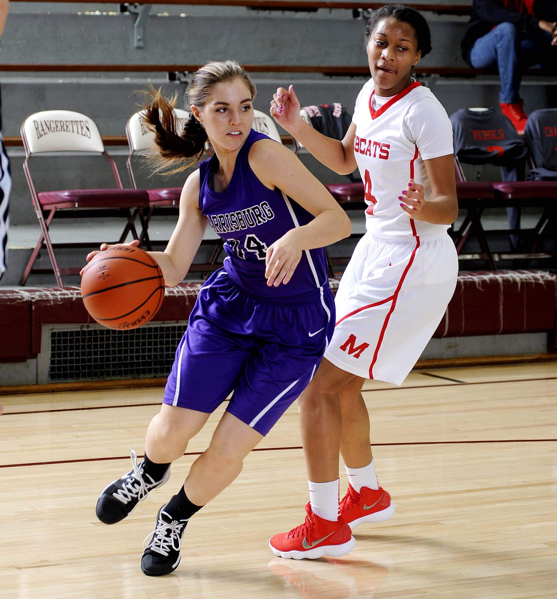 Harrisburg's Madeline Rider drives baseline for the Bulldogs in action against Meridian Wednesday at the Rangerette Classic at Benton High School