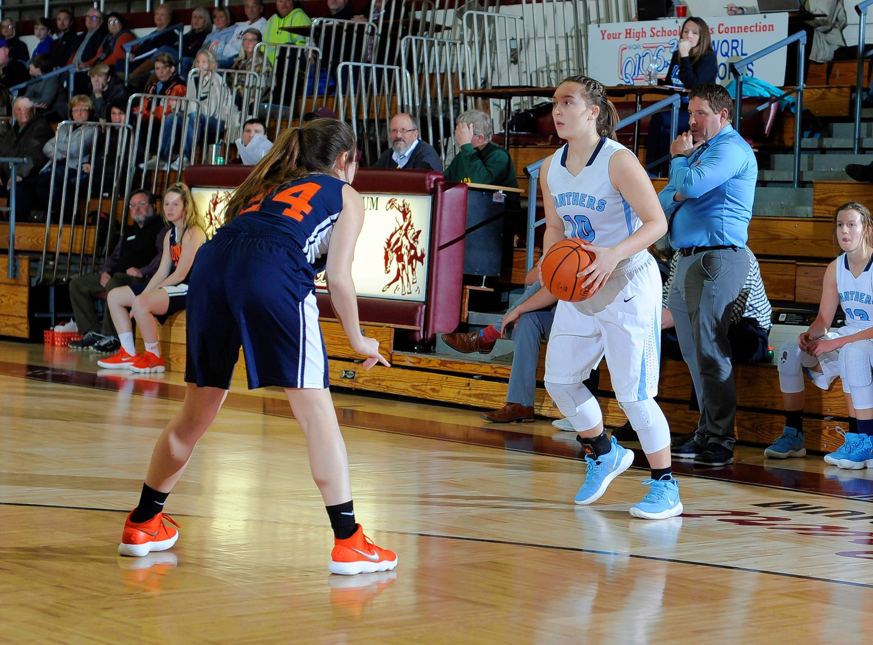Sophomore Elaine Shaneyfelt surveys the Carterville defense in game action Thursday at the Benton Holiday Tournament.