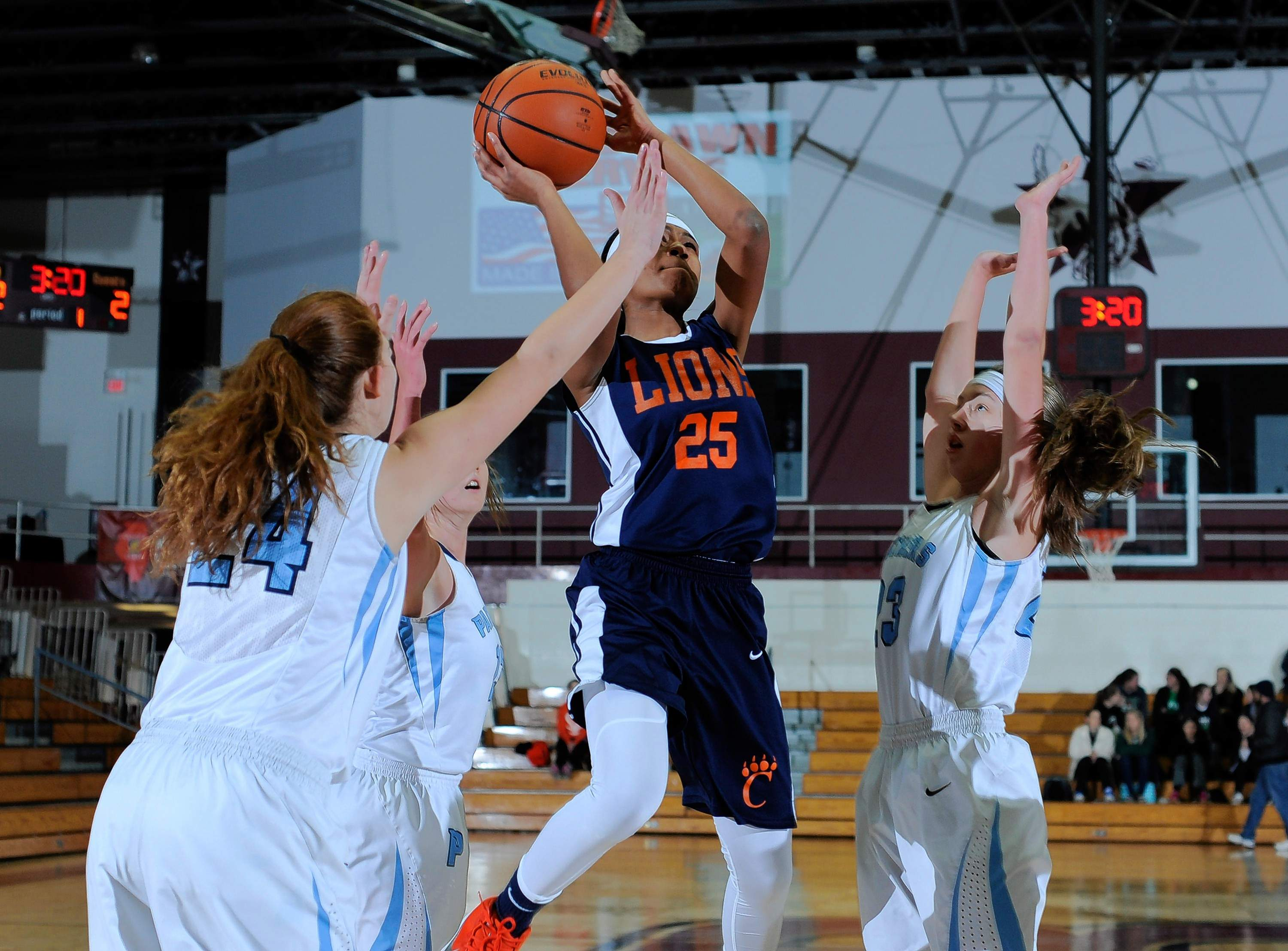 Sophomore Megan Barton of Carterville goes up for a shot over Bella Pasquino of the Panthers Thursday night.