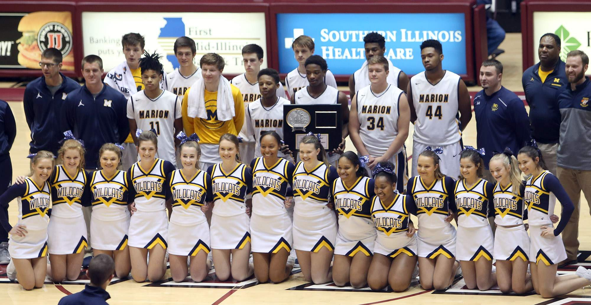 Marion poses with the AA title trophy.