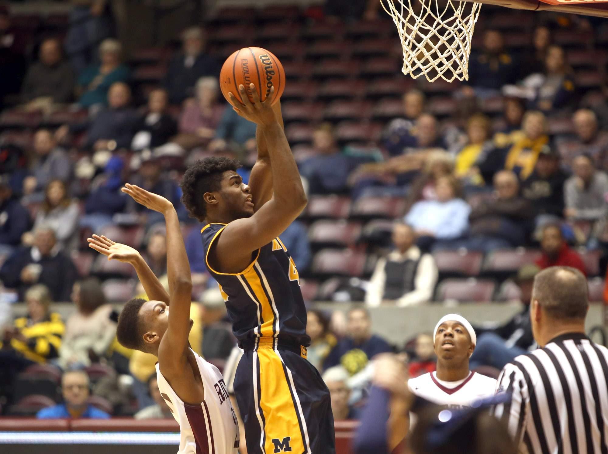Terrell Henderson attempts a shot.