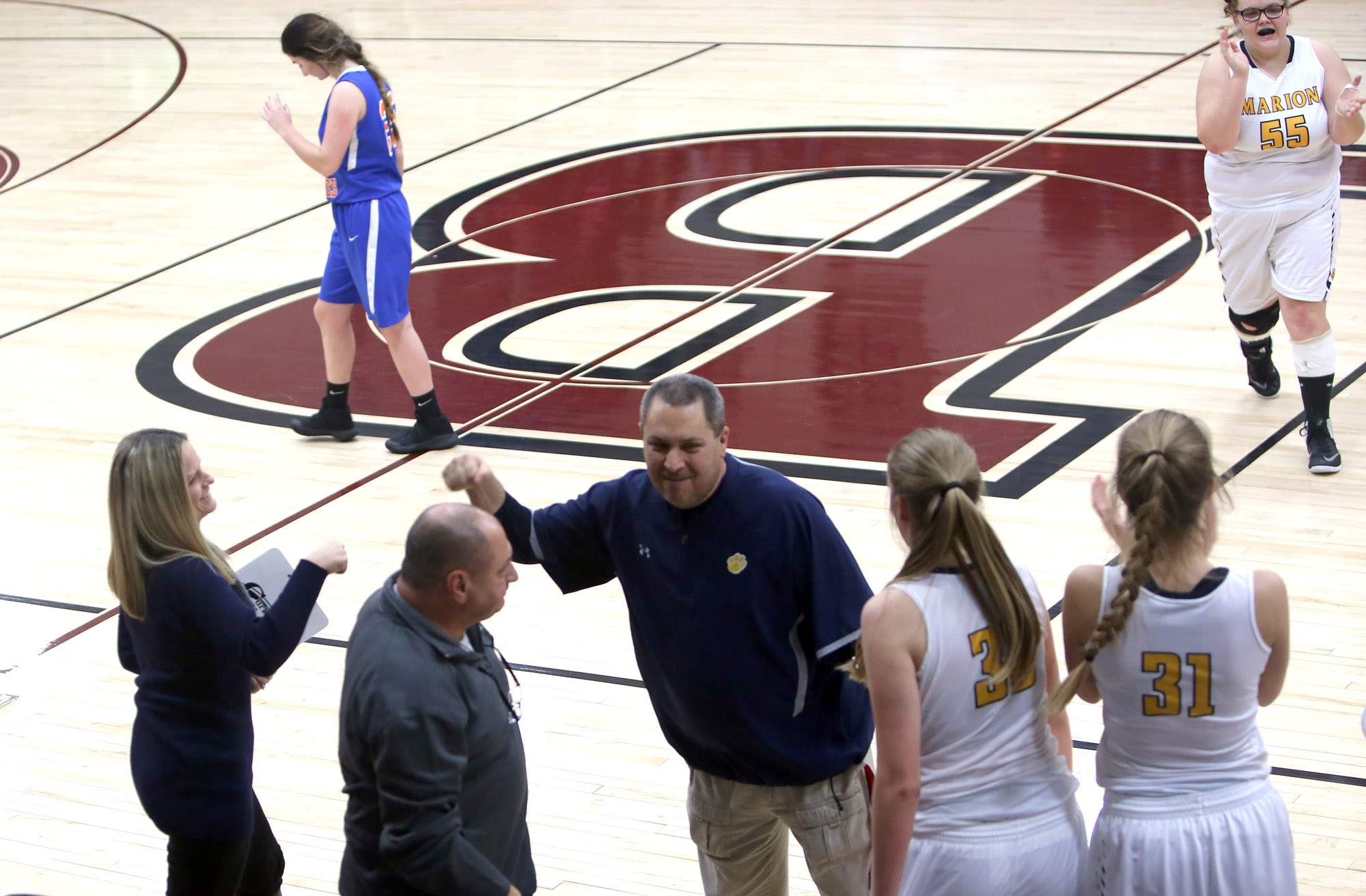 Marion head coach Mike Manfredo gives a fist bump to assistant coach Jaime Clark-Verbeck after Friday's win over Vienna at the Benton Rangerette Christmas Classic.