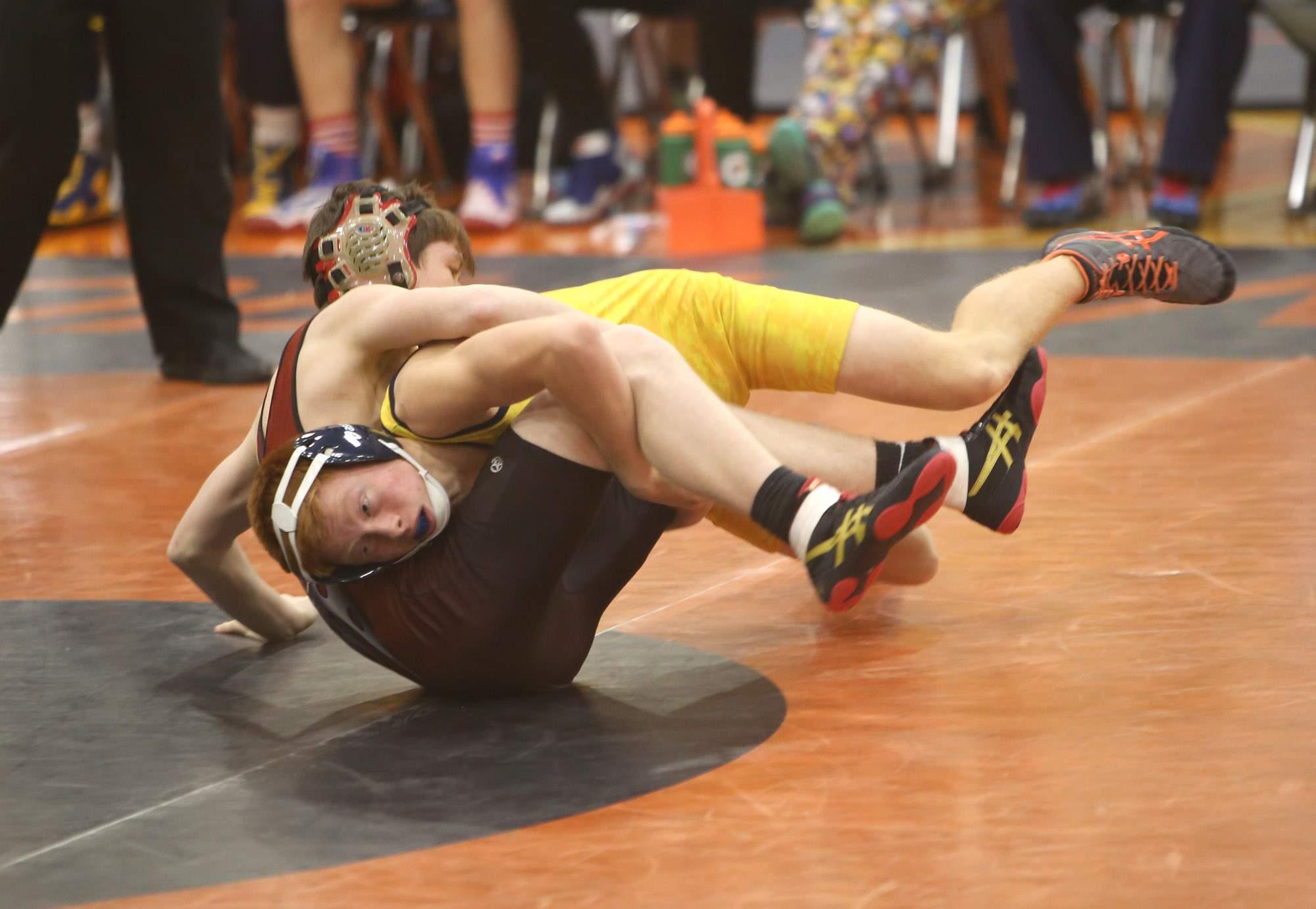 Riley Winters wrestles against Fairfield.