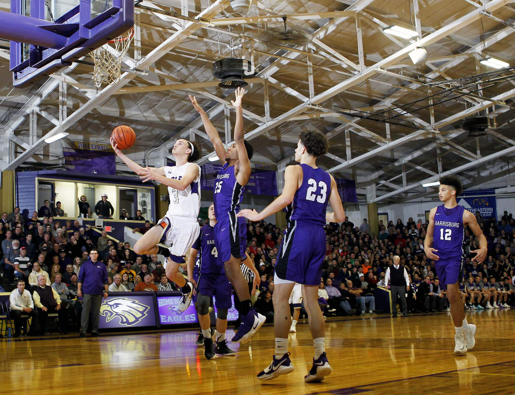 Eldorado's John Meredith goes up for two of his team-high 18 points en route to the EHT's Most Valuable Player Award as the Eagles beat Harrisburg 56-49 Saturday night.