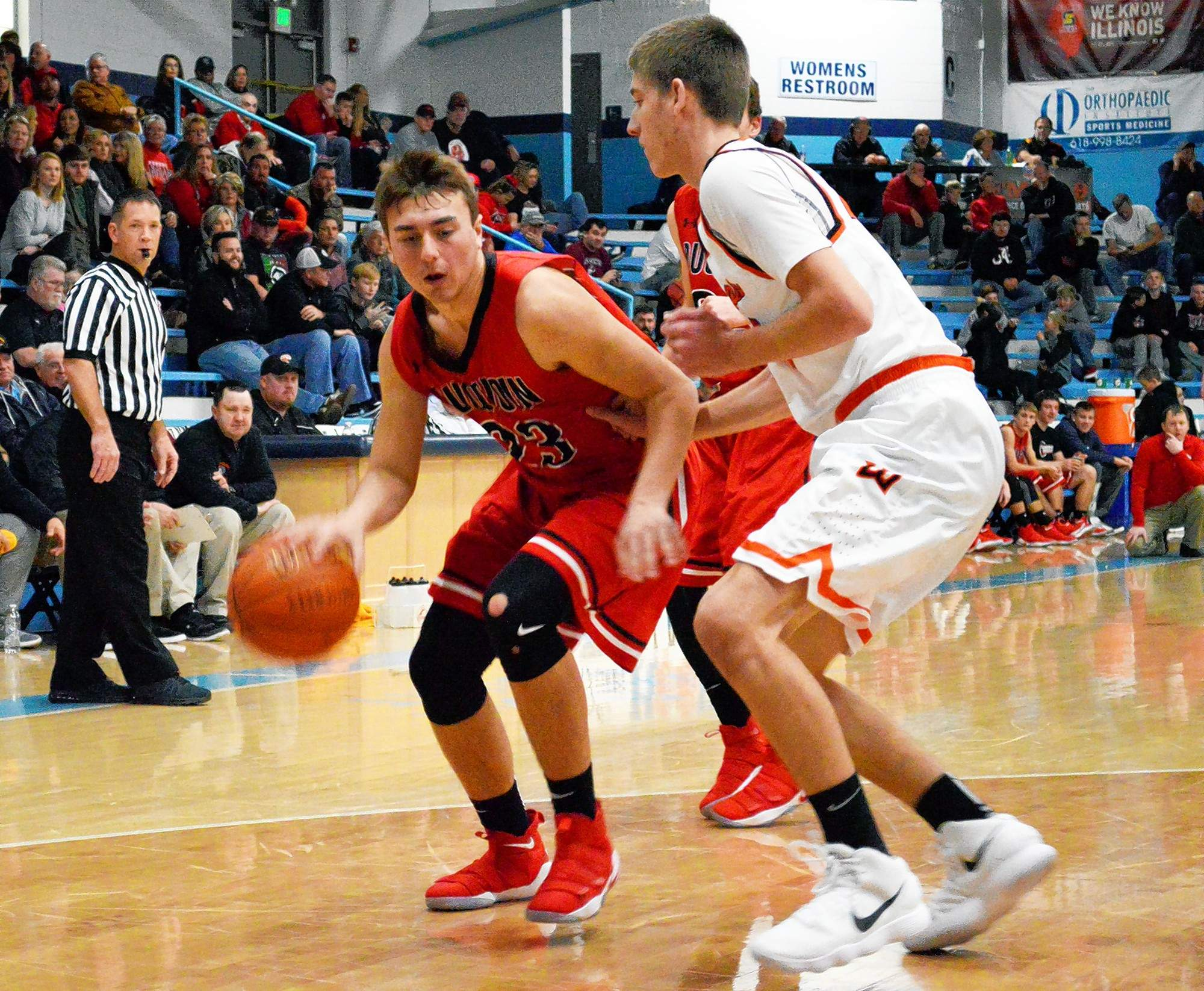 Du Quoin's Braeden Pursell (left) keeps possession of the ball against a Wesclin defender Saturday afternoon during the first round of the Gold Pool games of the Duster Thomas Hoops Classic.