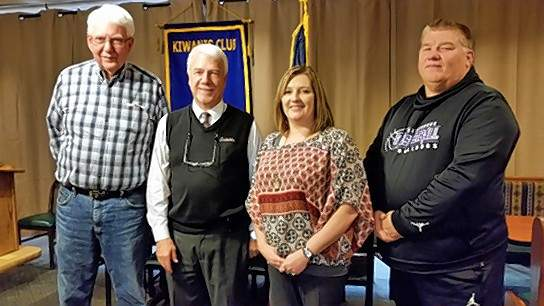 Program sponsor Marvin Lollar, far left, and Kiwanis Vice President Amy Short welcome guest speakers Randy Smithpeters and Richard Dwyer.
