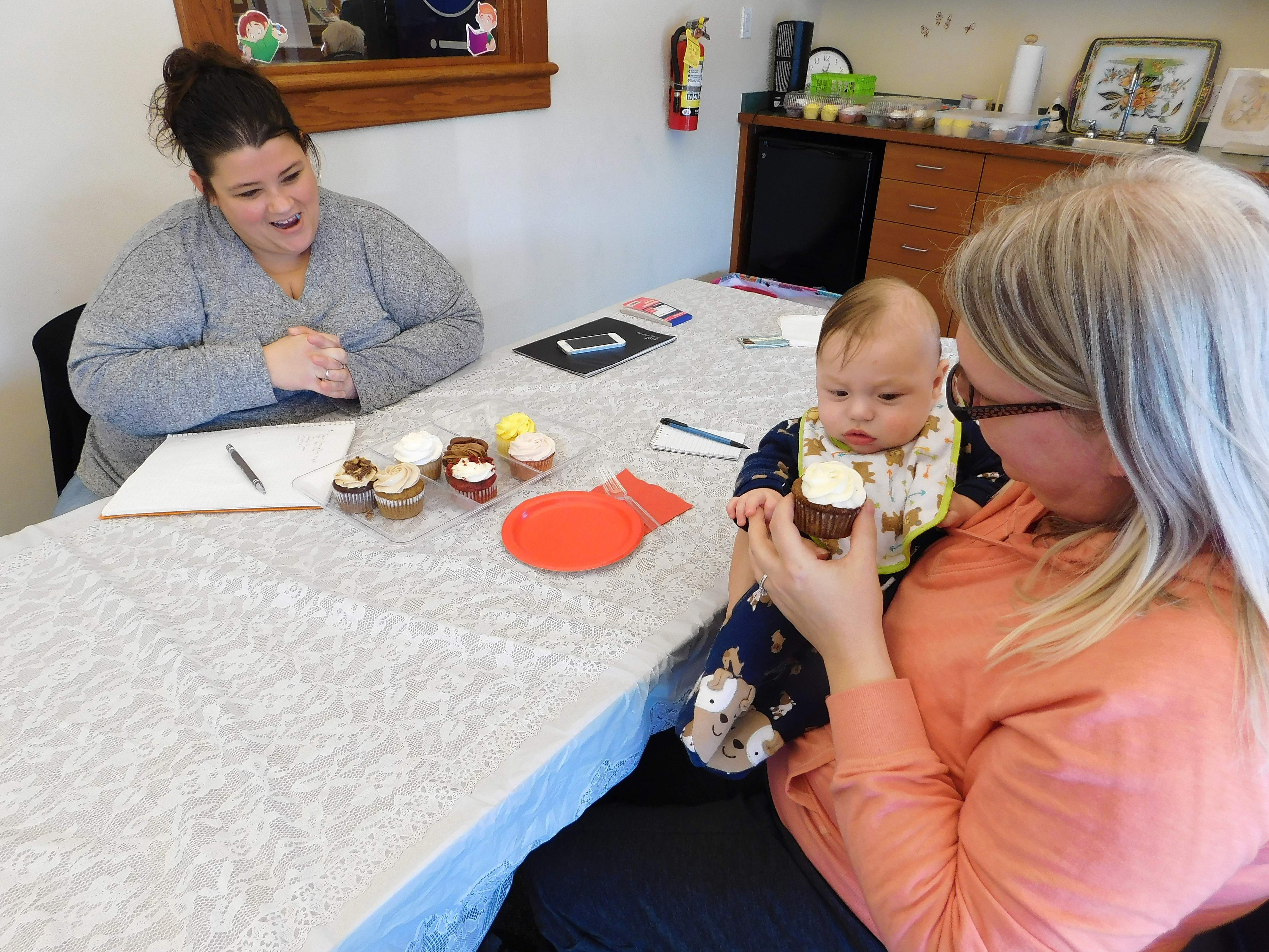 Alecia Schnaiter (left), owner of Sweet Treats in Benton, spent last Saturday holding tastings at the Benton Public Library. Several brides stopped by to sample Schnaiter's cake flavors, including Sarah Nelson and her 4-month-old son, Jacob. Nelson will marry Peter Ksycki April 14 in Breese.