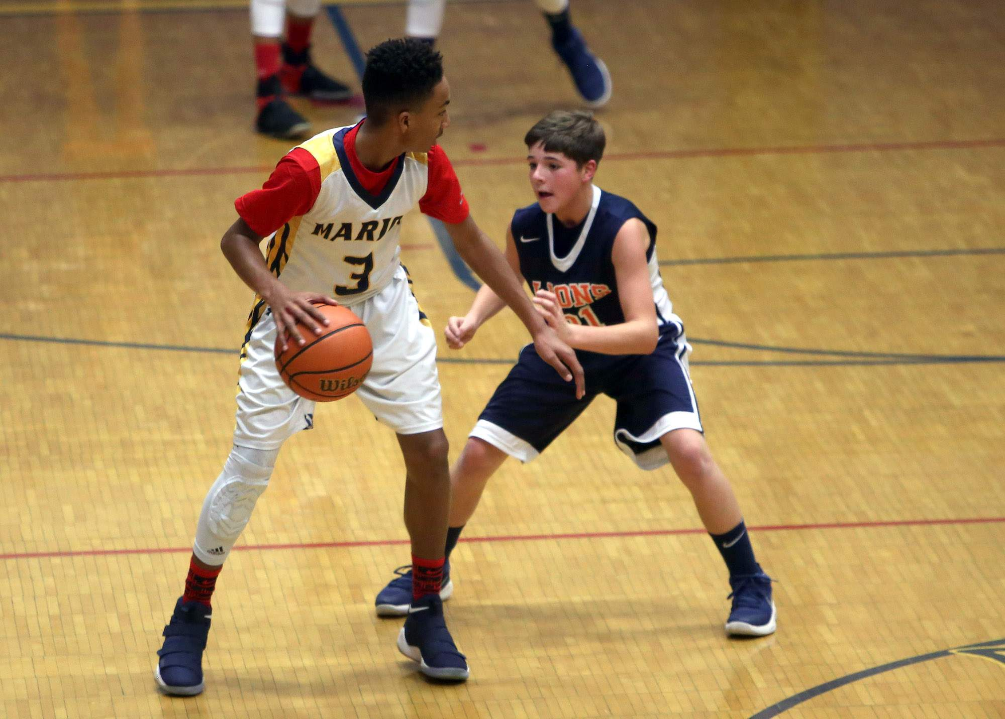 Venson Newsom is guarded by Caden Hawkins.