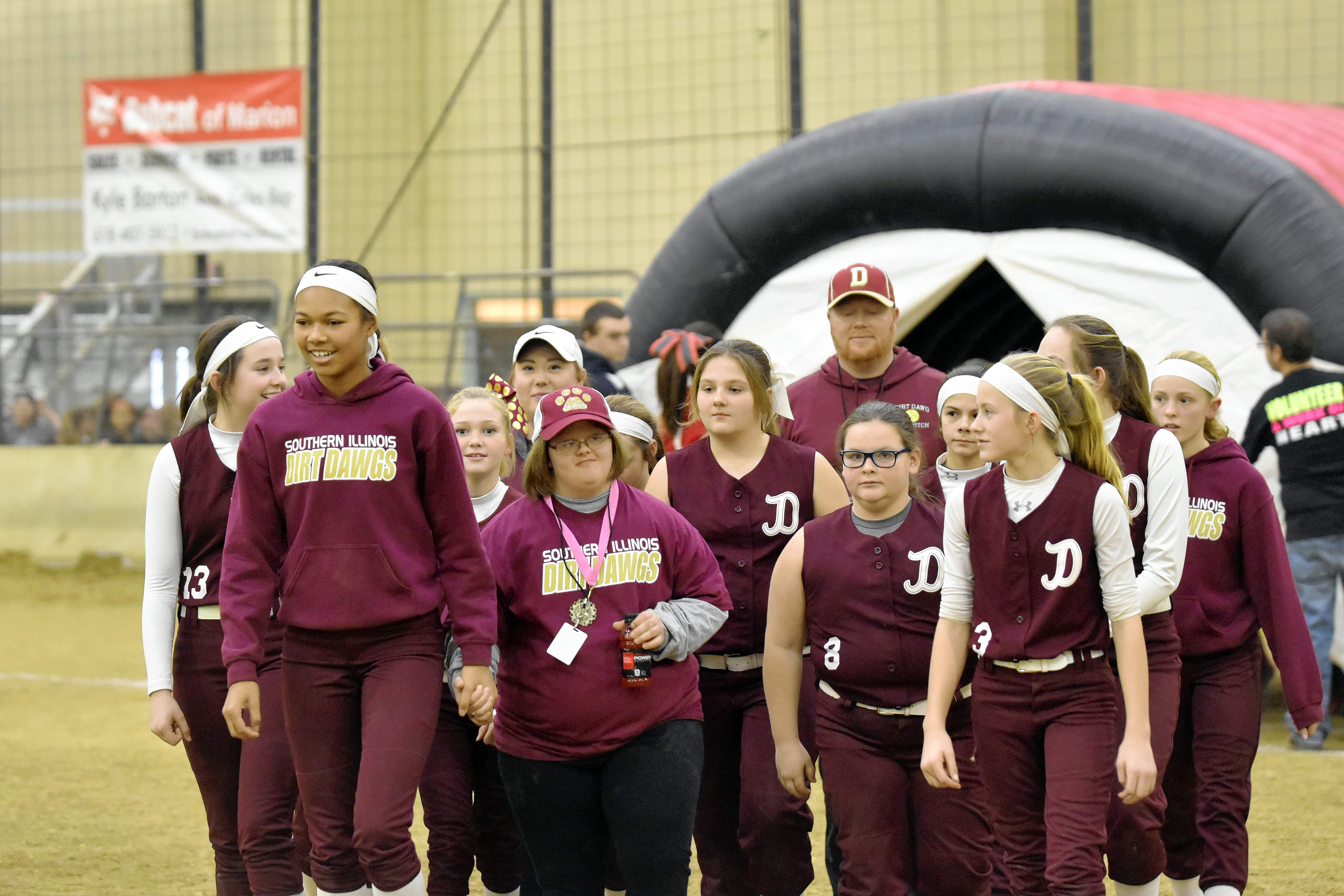 The Southern Illinois Dirt Dawgs are shown during the opening ceremony with their Special Olympics athlete in Brenna Asbury.