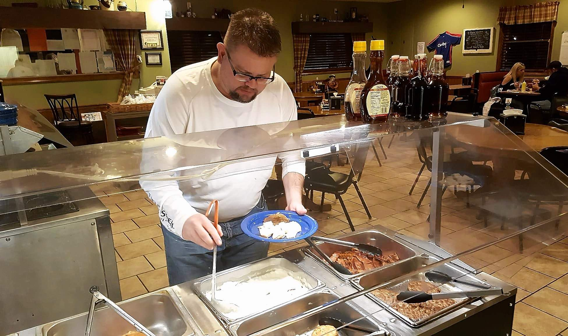 Michael McGuire, who describes himself as a 'multiple buffet user,' recently enjoyed his second consecutive night at the Bonz Fire Grill's new all-night breakfast buffet. Responding to customer suggestions on Facebook, the Benton eatery decided to give an affordable all-night buffet a chance, offering the $5 buffet as well as the regular menu Friday and Saturday evenings from 10 until 5 p.m. 'I like it a lot,' McGuire said, filling his second plate with homemade biscuits and gravy. 'It's got everything I like to eat. I ate it last night, too.'