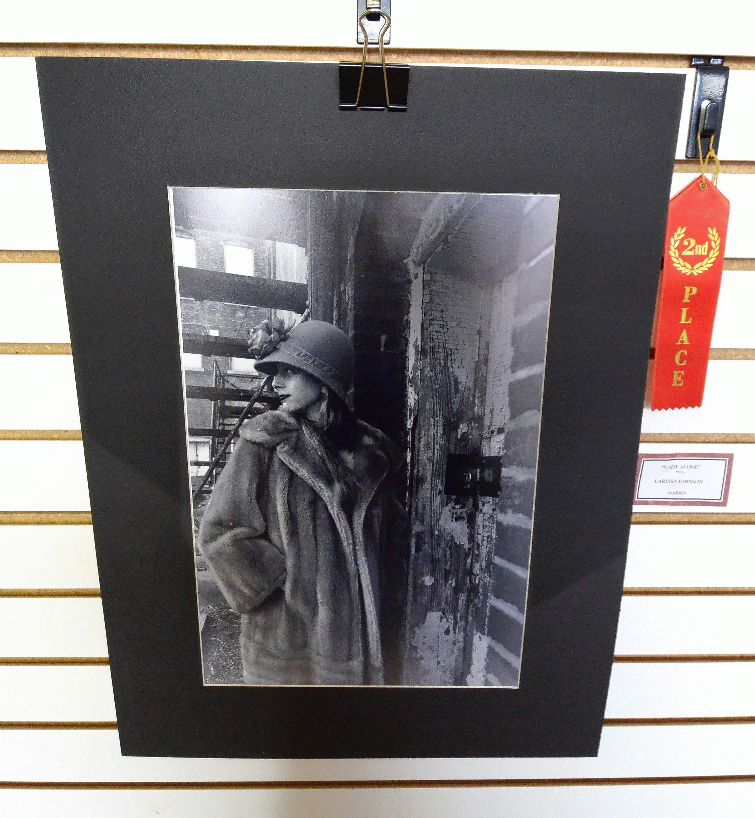 This striking black and white photograph by Marion High School student Larissa Johnson titled, 'Lady Alone,' earned the young photographer a second-place ribbon in the show.