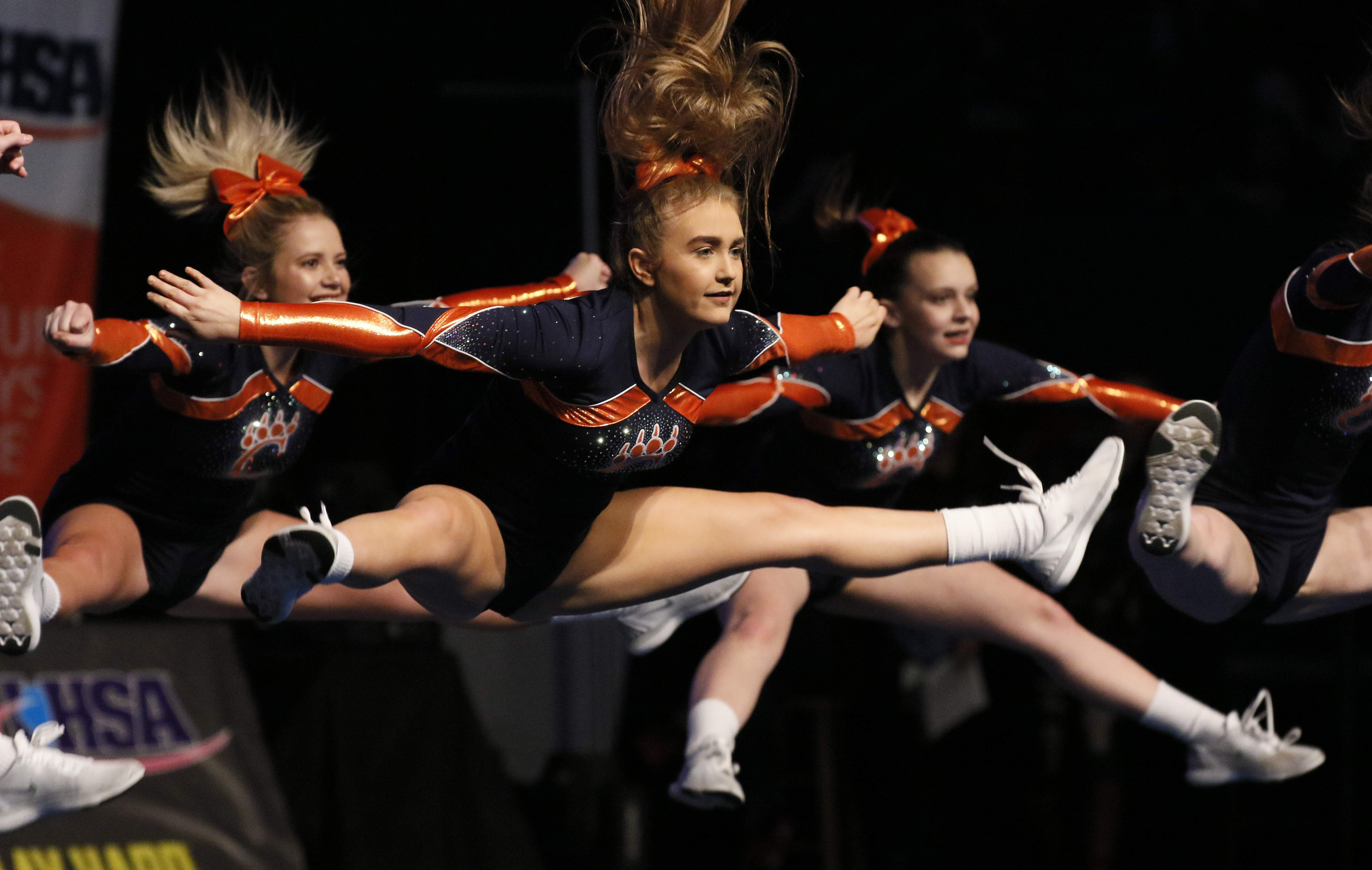 The Carterville cheerleaders go airborne in the preliminary round of the IHSA Cheerleading finals in Bloomington on Feb. 2.