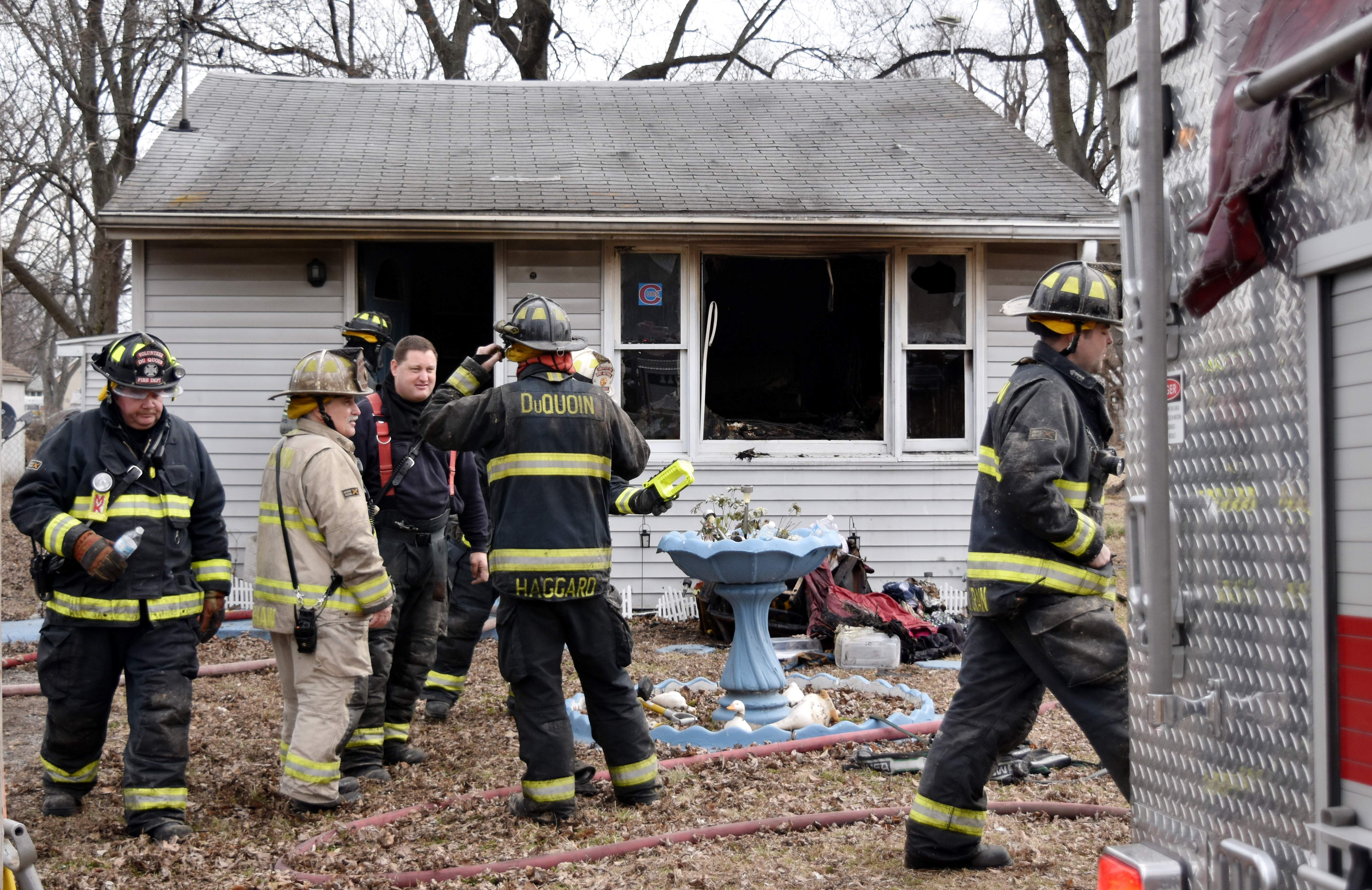 Firefighters prepare to clear the scene from a house fire on Linden Street on Friday.