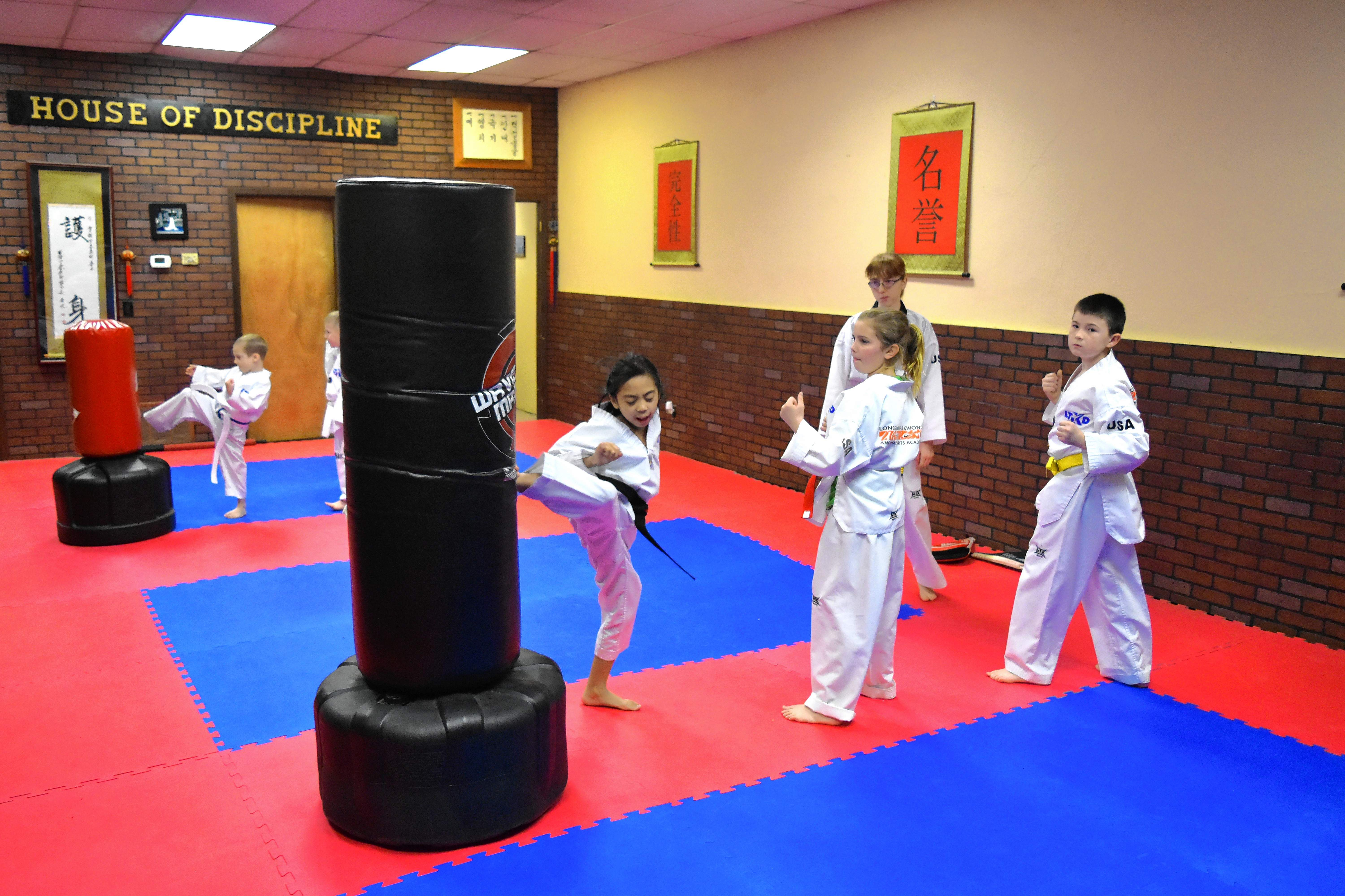 Students at Longshore's Tae Kwon Do and Martial Arts Academy practice their kicks on Tuesday at their West Main Street dojo.