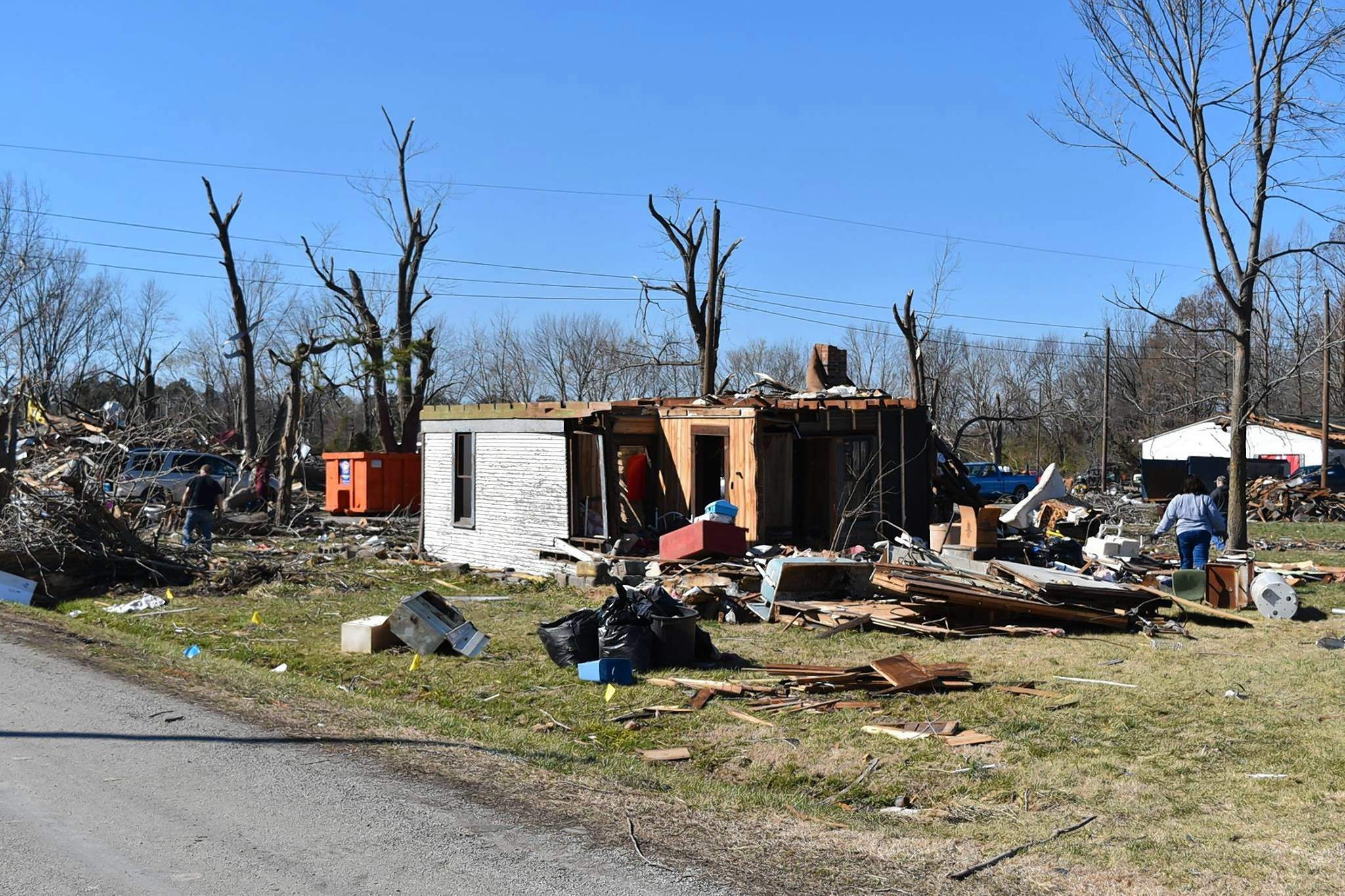 "People work on cleaning up the aftermath of an EF-4 tornado in Elkville's Chamestown Road neighborhood on March 2, 2017. The tornado, dubbed the ""Fat Tuesday tornado,"" killed one person, injured 12 others and damaged 162 homes in two states when it struck on Feb. 28, 2017."