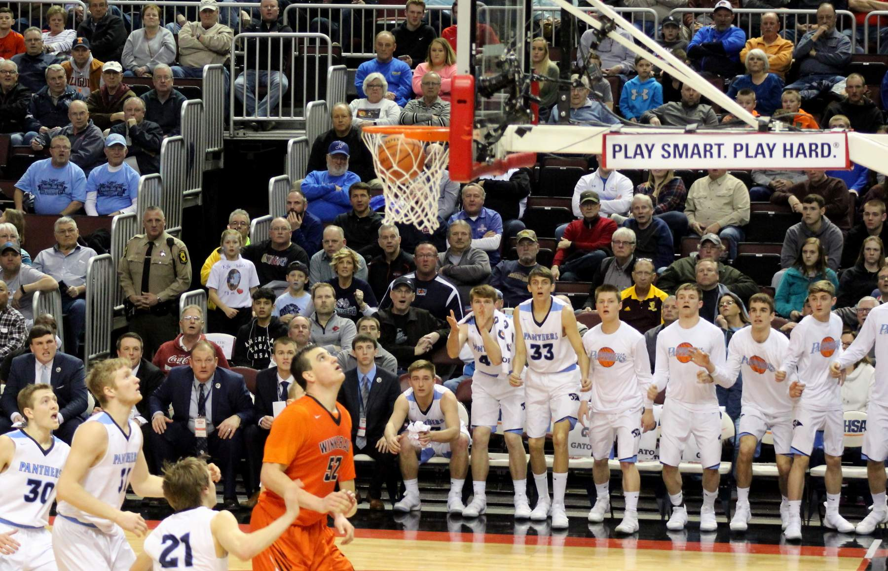 Dawson Yates' (not pictured) shot goes in as the coaches and players react.