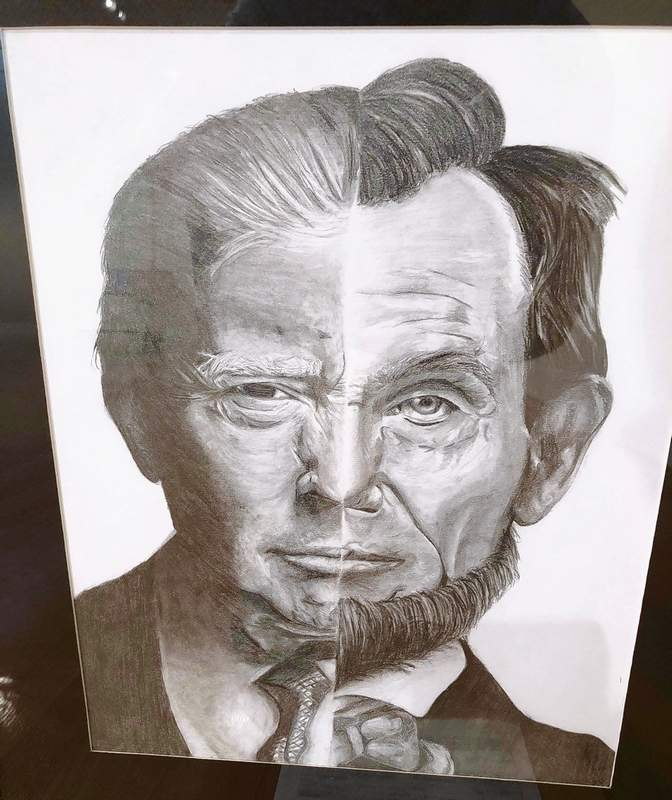 "Fallon Dawson earned a 3rd place in the 12th Congressional Art Show with her pencil drawing titled ""157,"" a pencil drawing of presidents Abraham Lincoln and Donald Trump."